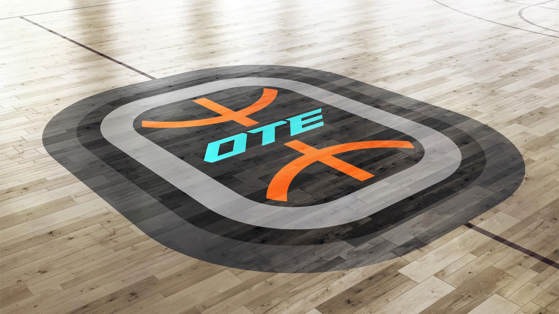 An Overtime logo on a basketball court