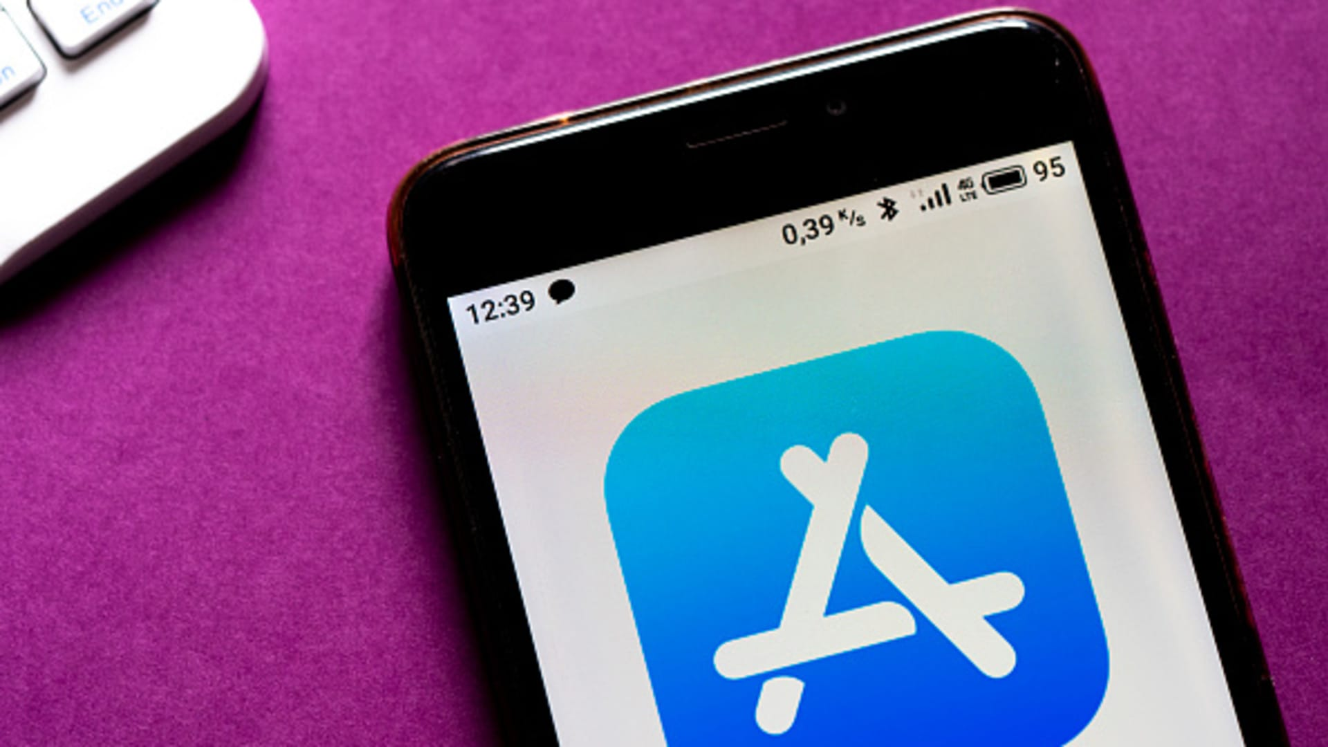 The App Store logo displayed on a smartphone.