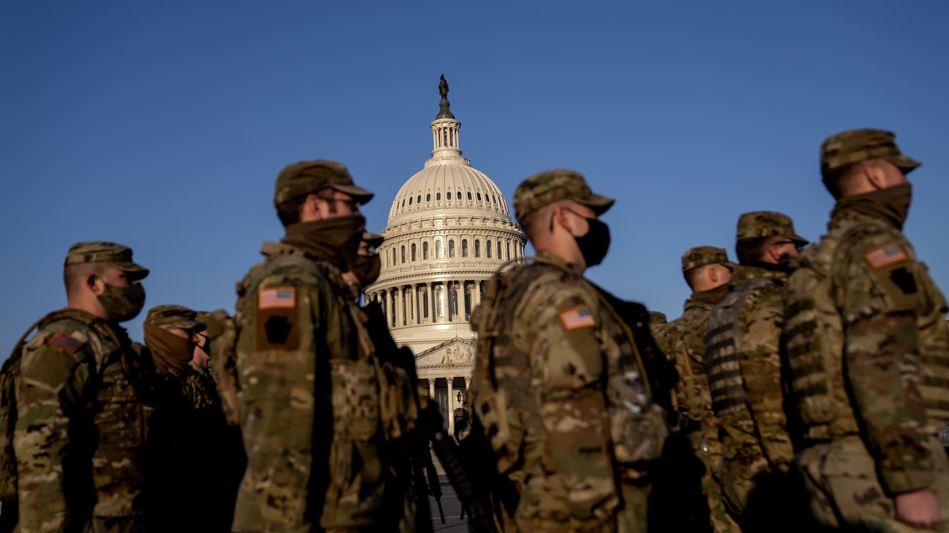 Members of the National Guard gather outside the U.S. Capitol in Washington, D.C., U.S., on Thursday, March 4, 2021.