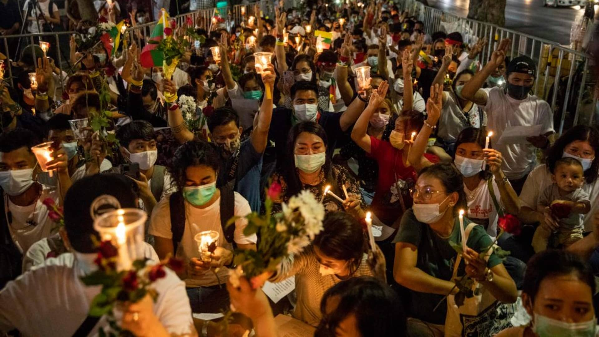 Myanmar nationals hold a candlelight vigil outside of the United Nations in remembrance of anti-coup protesters who have been killed in Myanmar on March 04, 2021 in Bangkok, Thailand.