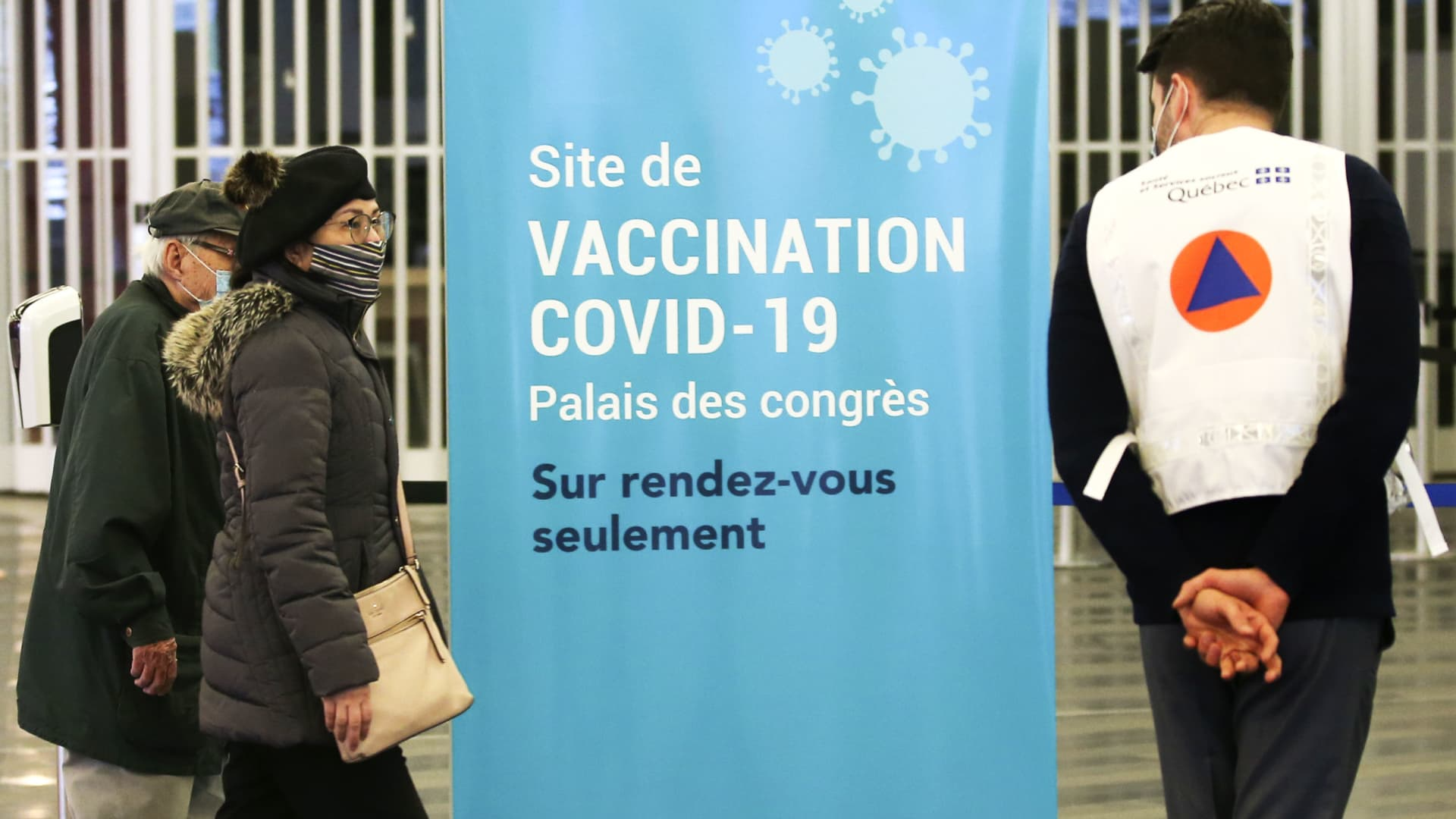 People arrive to be vaccinated at the Palais Des Congres convention centre in Montreal, Quebec, Canada, on Monday, March 1, 2021.