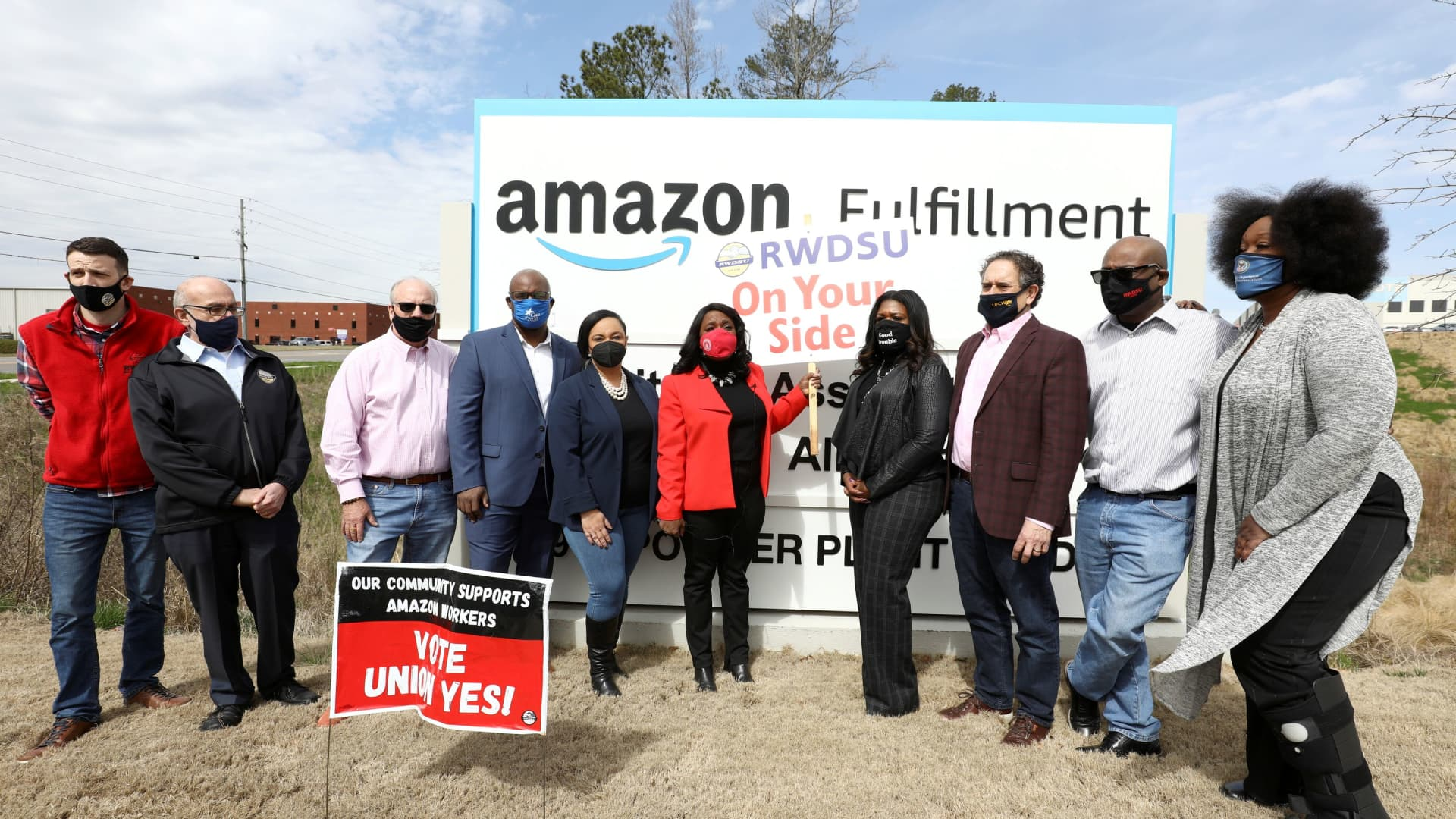 Rep. Nikema Williams, Rep. Jamaal Bowman, Rep. Terri Sewell, Rep. Cori Bush, Rep. Andy Levin and RWDSU President Stuart Appelbaum pose for a picture at the entrance to Amazon facility as they arrive as members of a congressional delegation to show their support for workers who will vote on whether to unionize, in Birmingham, Alabama, U.S. March 5, 2021.