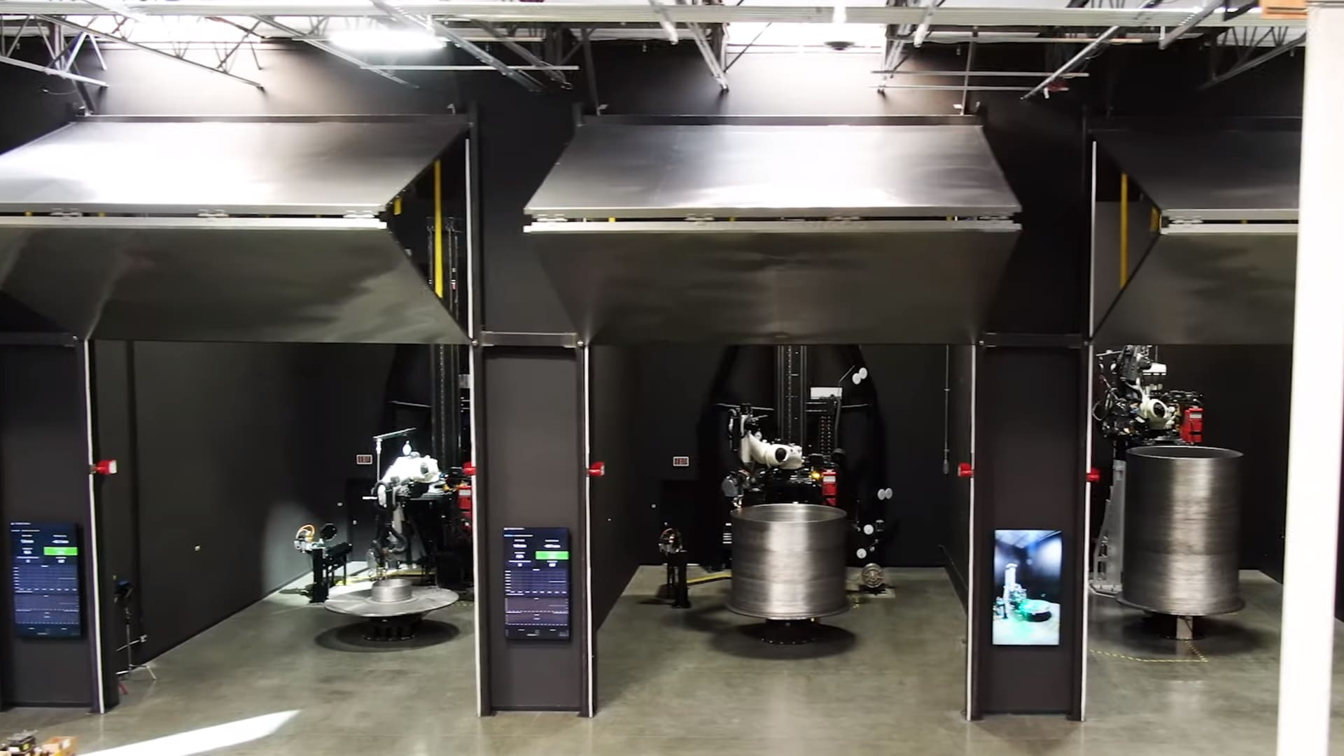 The row of two-story tall 3D printer bays at the company's headquarters.