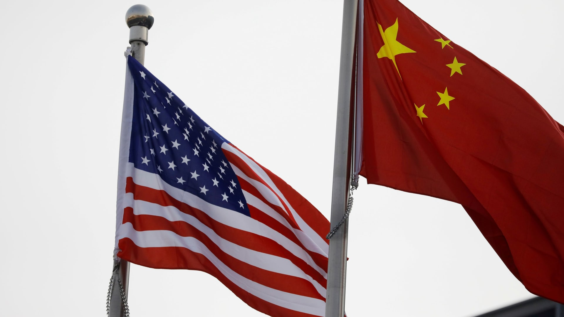 Chinese and U.S. flags outside the building of an American company in Beijing, China January 21, 2021.