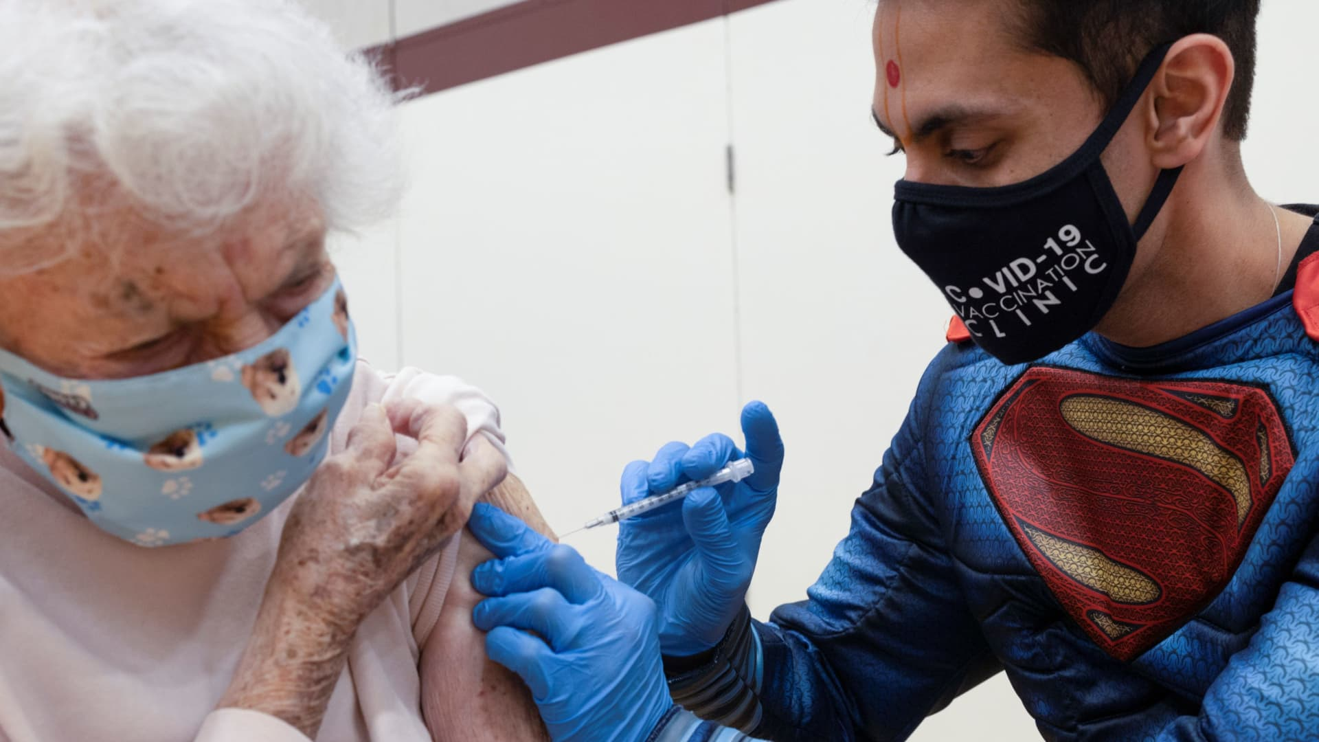 Dr. Mayank Amin administers the Pfizer-BioNTech coronavirus disease (COVID-19) vaccine to Helen Pepe, 94, at a clinic ran by Skippack Pharmacy in Collegeville, Pennsylvania, March 7, 2021.