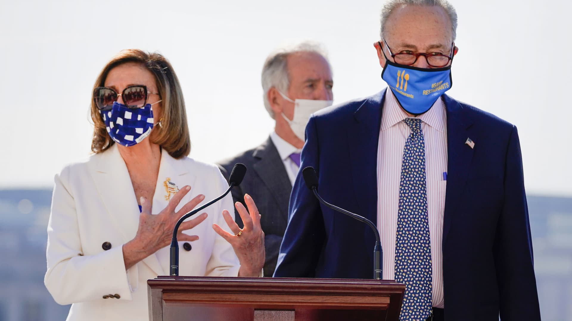 House Speaker Nancy Pelosi of Calif., speaks as Senate Majority Leader Chuck Schumer of N.Y., listens during an enrollment ceremony for the $1.9 trillion COVID-19 relief bill, accompanied by Senate Majority Leader Chuck Schumer of N.Y., on Capitol Hill, Wednesday, March 10, 2021, in Washington.