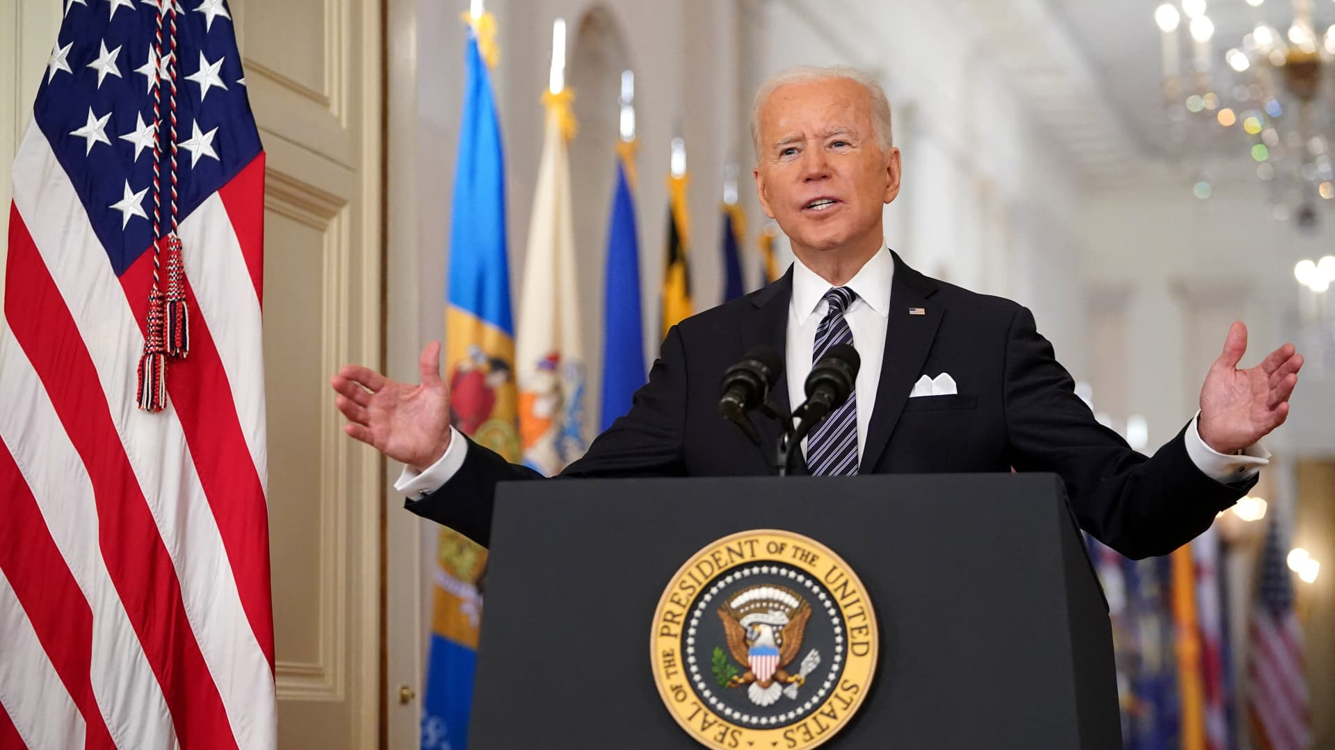 President Joe Biden gestures as he speaks on the anniversary of the start of the Covid-19 pandemic, in the East Room of the White House in Washington, DC on March 11, 2021.
