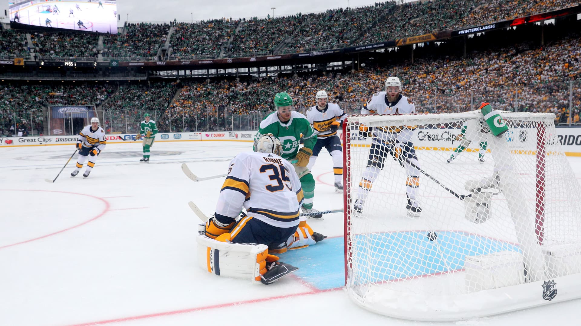 Joe Pavelski #16 and the Dallas Stars get a puck past Pekka Rinne #35 and the Nashville Predators during the Bridgestone NHL Winter Classic at Cotton Bowl on January 01, 2020 in Dallas, Texas.