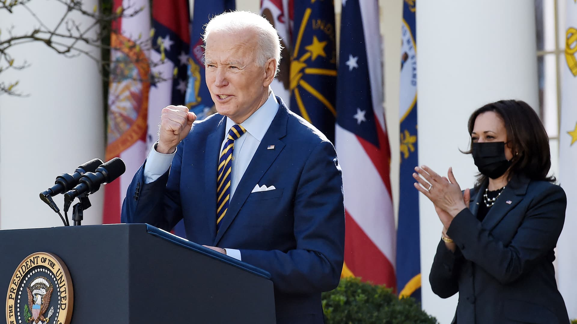 President Joe Biden, with Vice President Kamala Harris (R), speaks about the American Rescue Plan in the Rose Garden of the White House in Washington, DC, on March 12, 2021.