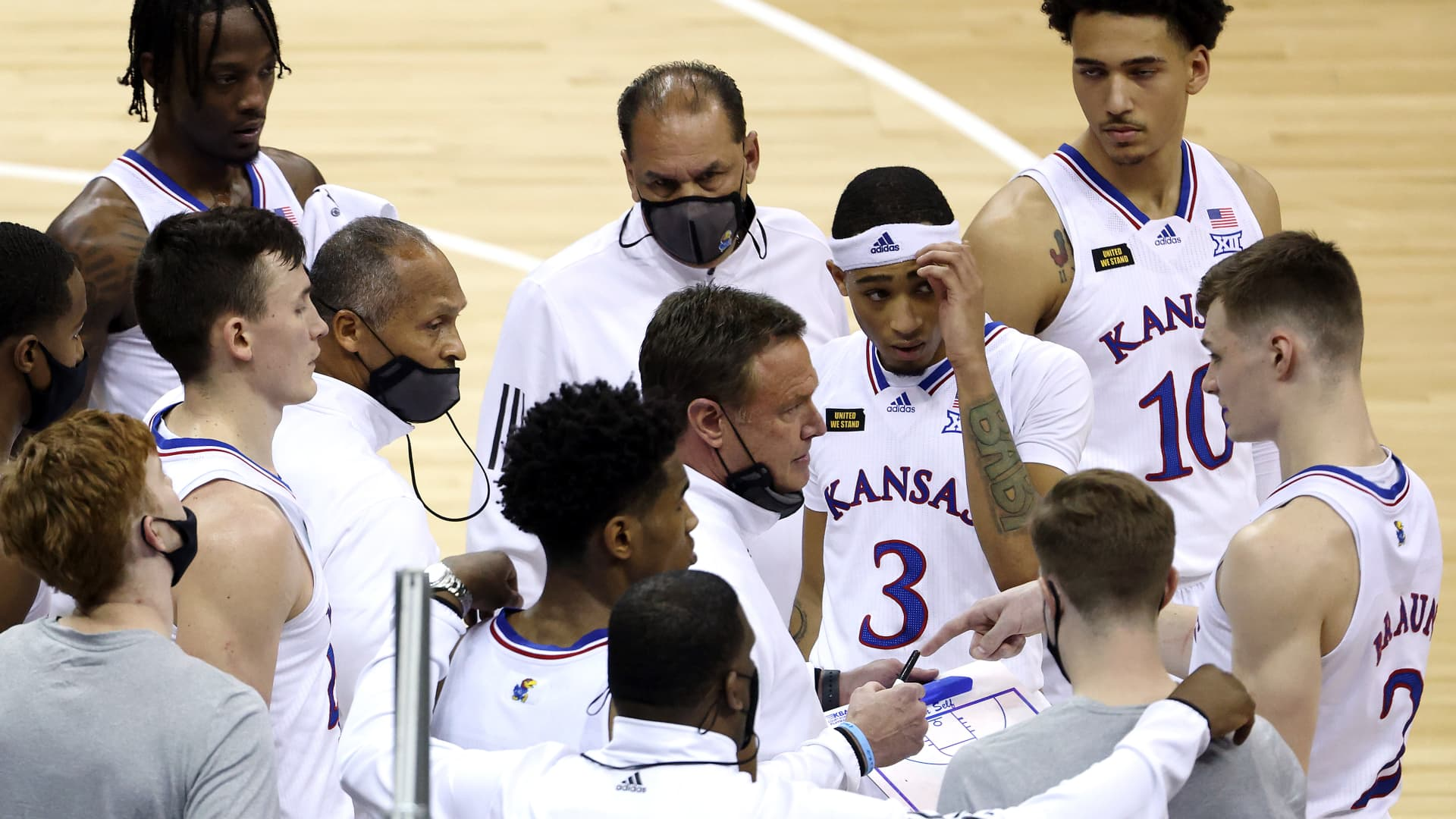 Head coach Bill Self of the Kansas Jayhawks talks with players during a timeout in the quarterfinal game of the Big 12 basketball tournament against the Oklahoma Sooners at the T-Mobile Center on March 11, 2021 in Kansas City, Missouri.