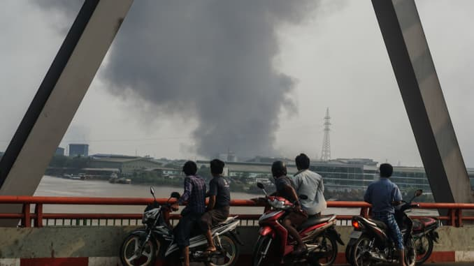 Smoke rises as protests against military coup and detention of elected government members continue in Hlaing Thar Yar Township, Yangon, Myanmar on March 14, 2021.