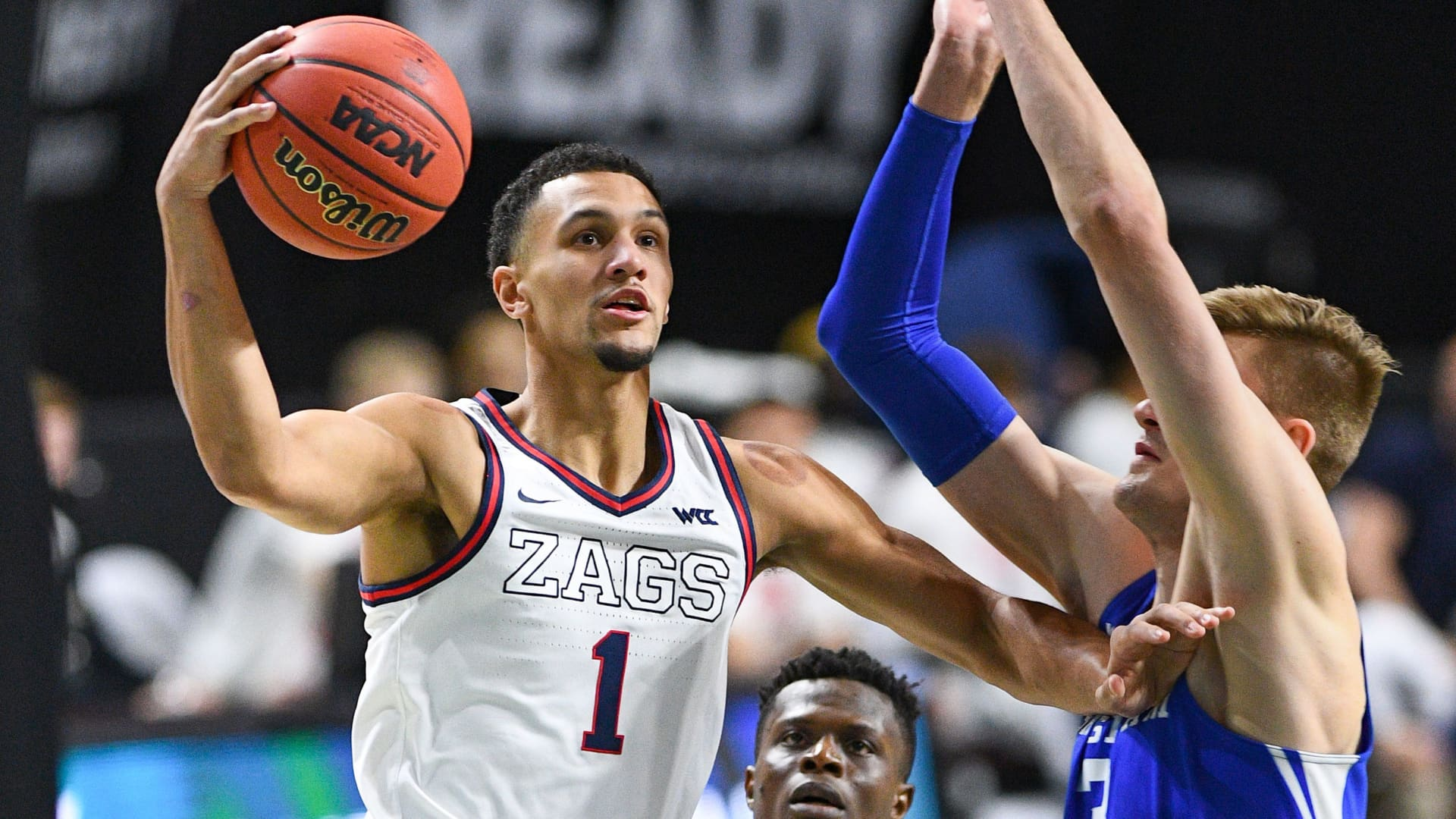 Gonzaga guard Jalen Suggs (1) drives to the basket against BYU forward Matt Haarms (3) during the championship game of the men's West Coast Conference basketball tournament between the BYU Cougars and the Gonzaga Bulldogs on March 9, 2021, at the Orleans Arena in Las Vegas, NV.