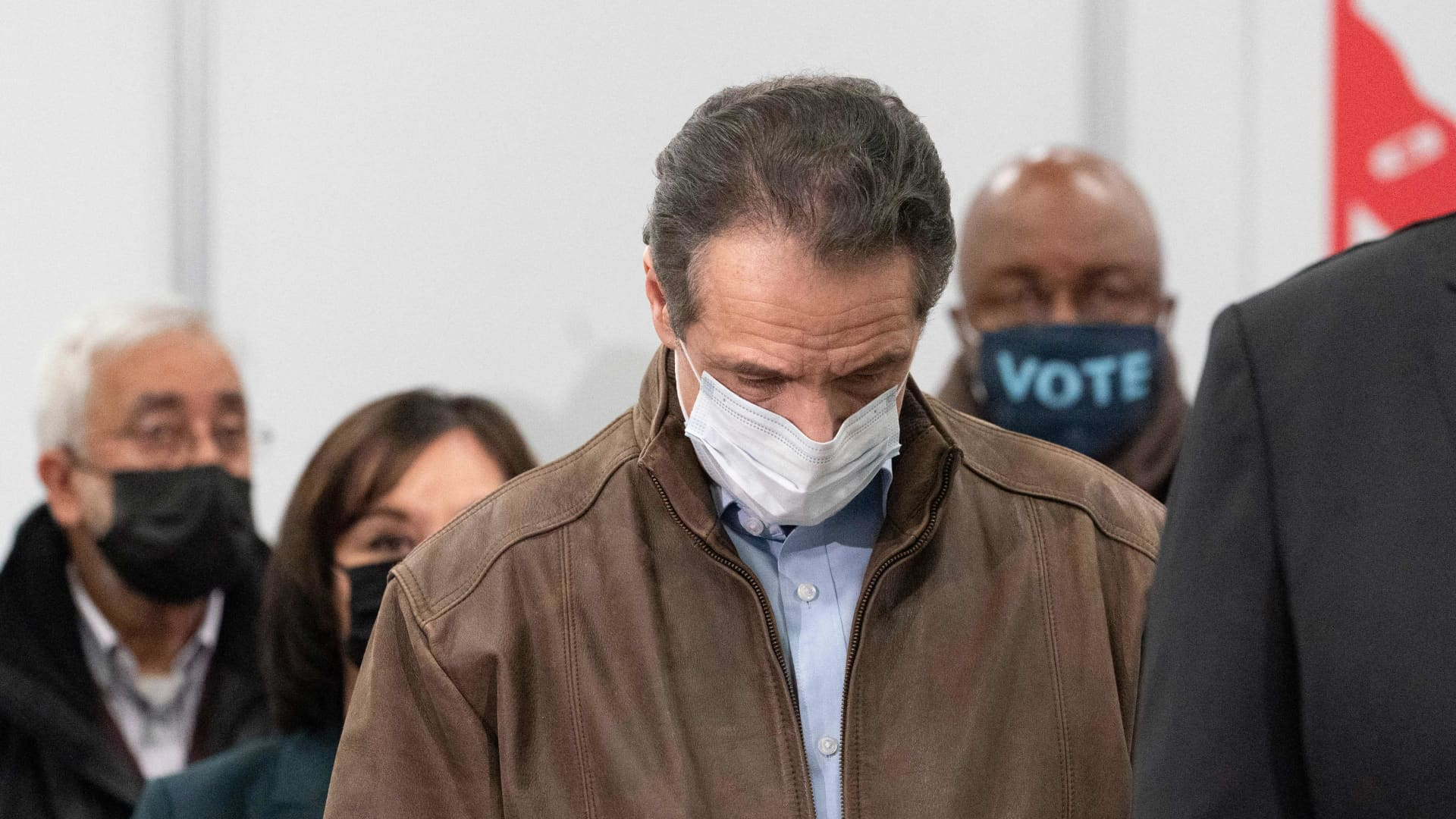 Governor Andrew Cuomo touches his nose during a visit to a new Covid-19 vaccination site, Monday, March 15, 2021, at the State University of New York in Old Westbury.