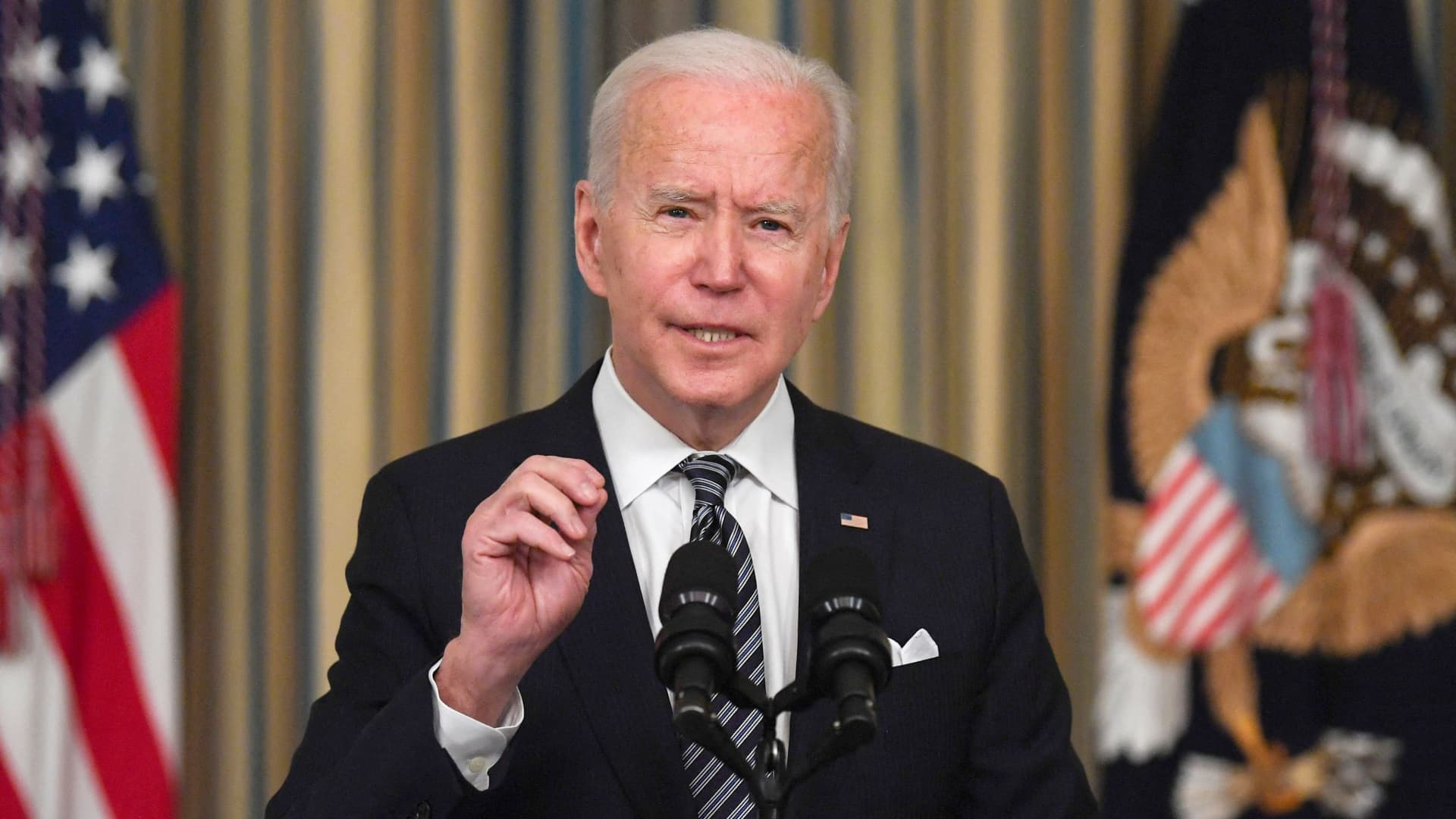 President Joe Biden gestures during remarks on the implementation of the American Rescue Plan in the State Dining room of the White House in Washington, DC on March 15, 2021.