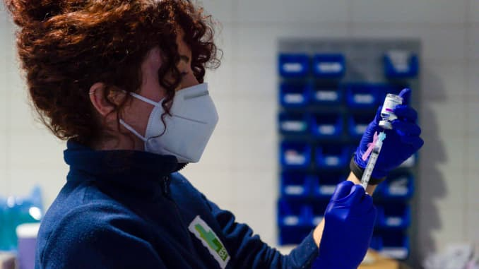 A healthcare worker prepares a syringe with the AstraZeneca Covid-19 dose at Coria City Hospital, Spain.