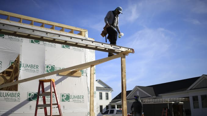 A contractor works on a house under construction at the Norton Commons subdivision in Louisville, Kentucky, U.S., on Monday, March 8, 2021.