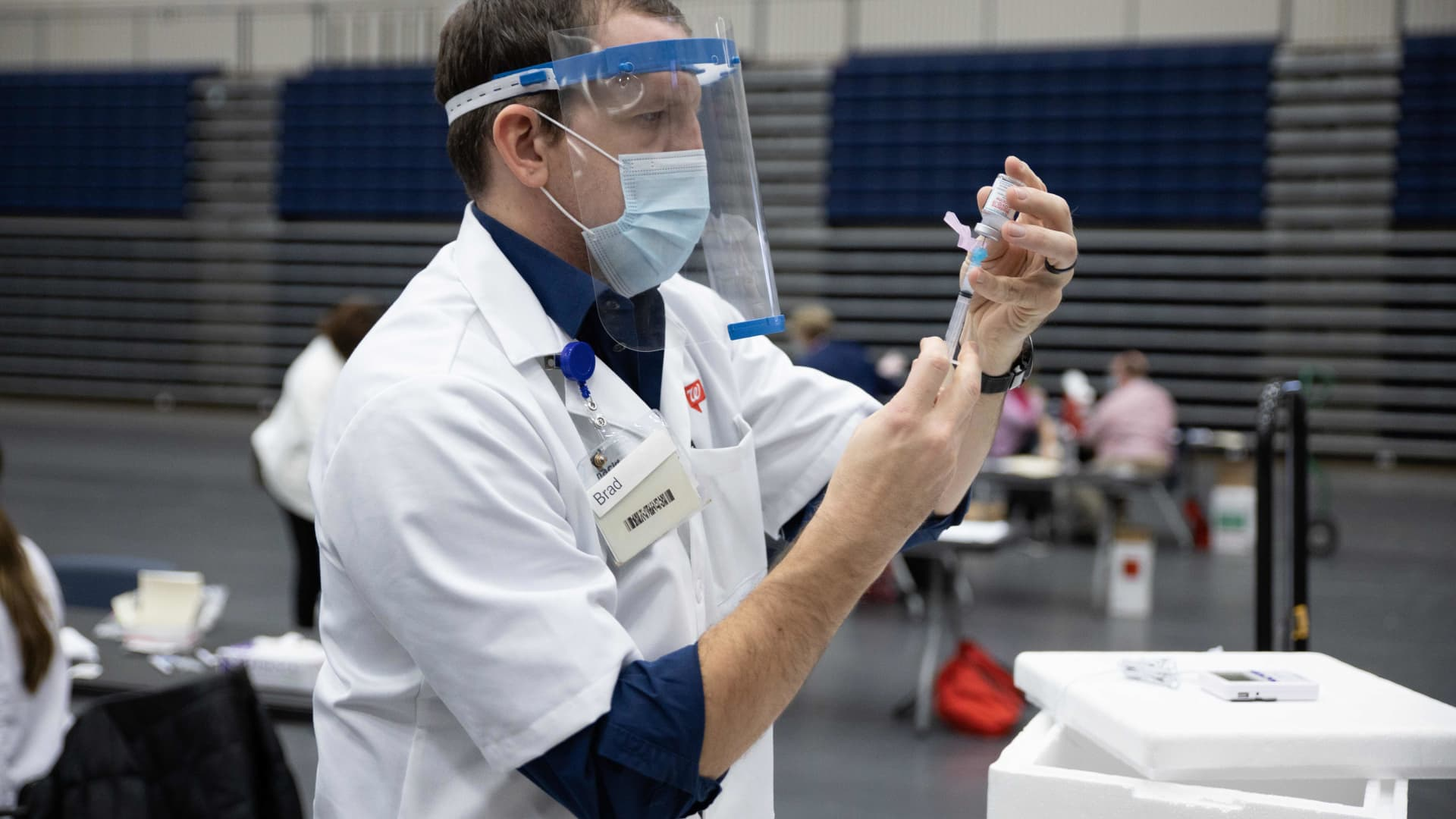 Walgreens staff prepare vaccines for Educational Staff at Kettering City Schools to receive the Covid-19 vaccine as a part of Ohio's Phase 1B vaccine distribution in Dayton, Ohio on February 10, 2021.