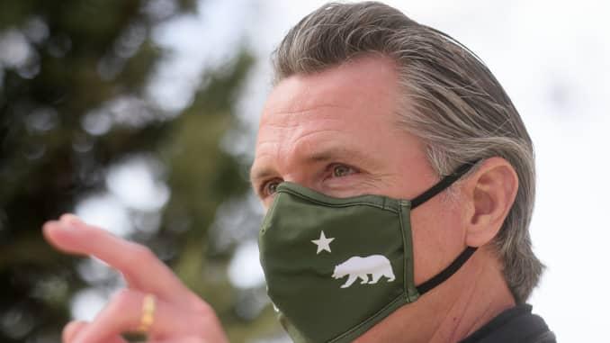 California Gov. Gavin Newsom visits a mobile COVID-19 vaccination center on March 10, 2021 in South Gate, California.