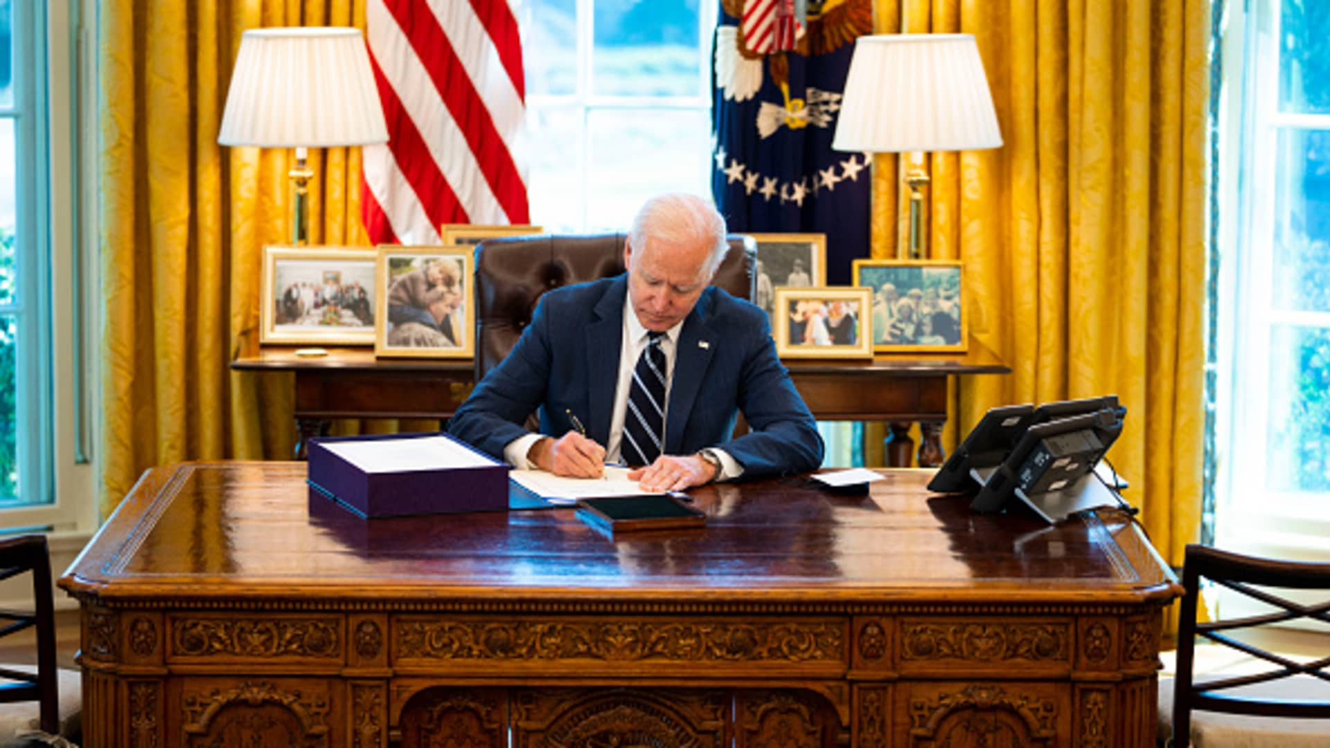 President Joe Biden signed the $1.9 trillion American Rescue Plan Act of 2021 on March 11 in the Oval Office.