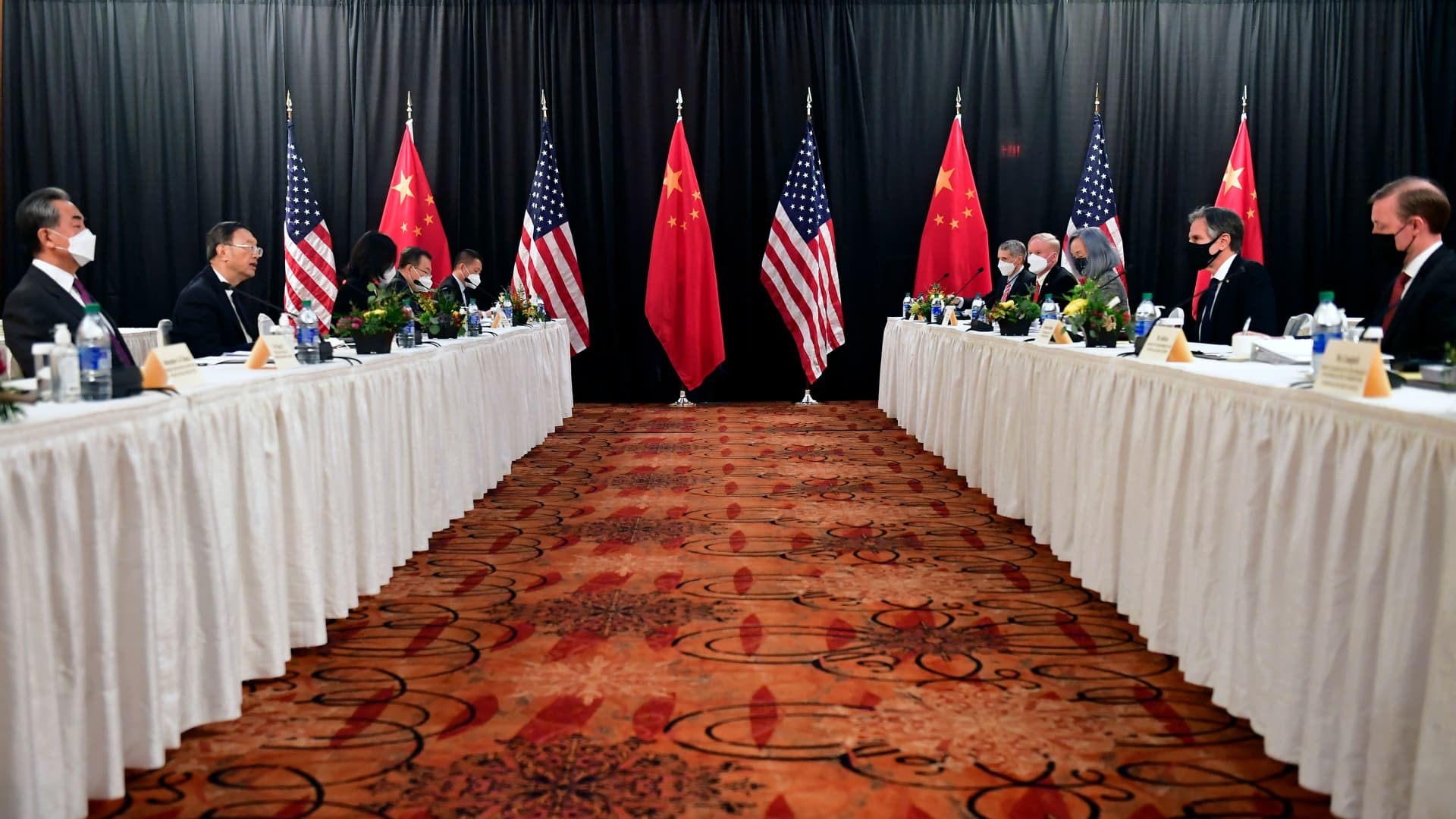 U.S. Secretary of State Antony Blinken (2nd R), joined by national security advisor Jake Sullivan (R), speaks while facing Yang Jiechi (2nd L), director of the Central Foreign Affairs Commission Office, and Wang Yi (L), China's foreign minister at the opening session of U.S.-China talks at the Captain Cook Hotel in Anchorage, Alaska on March 18, 2021.