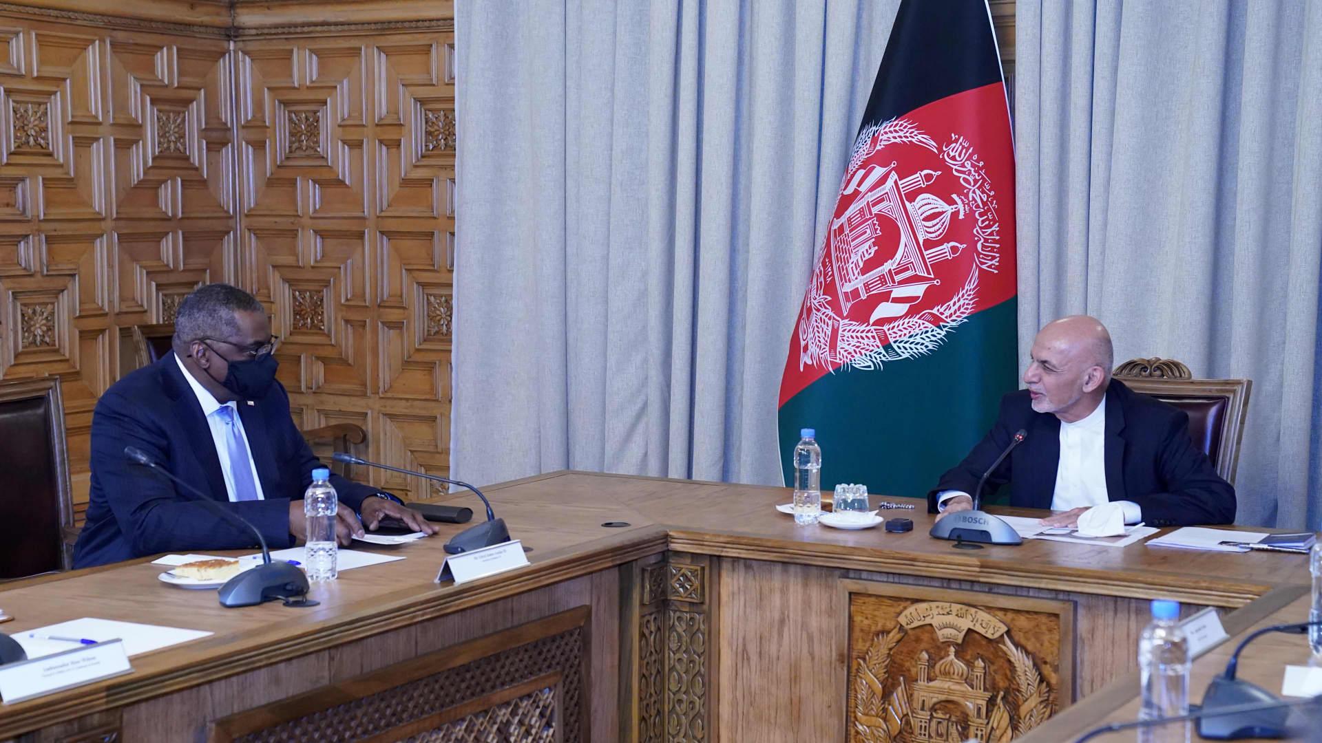 Afghanistan's President Ashraf Ghani (R) meets U.S. Secretary of Defense Lloyd Austin, in Kabul, Afghanistan March 21, 2021.