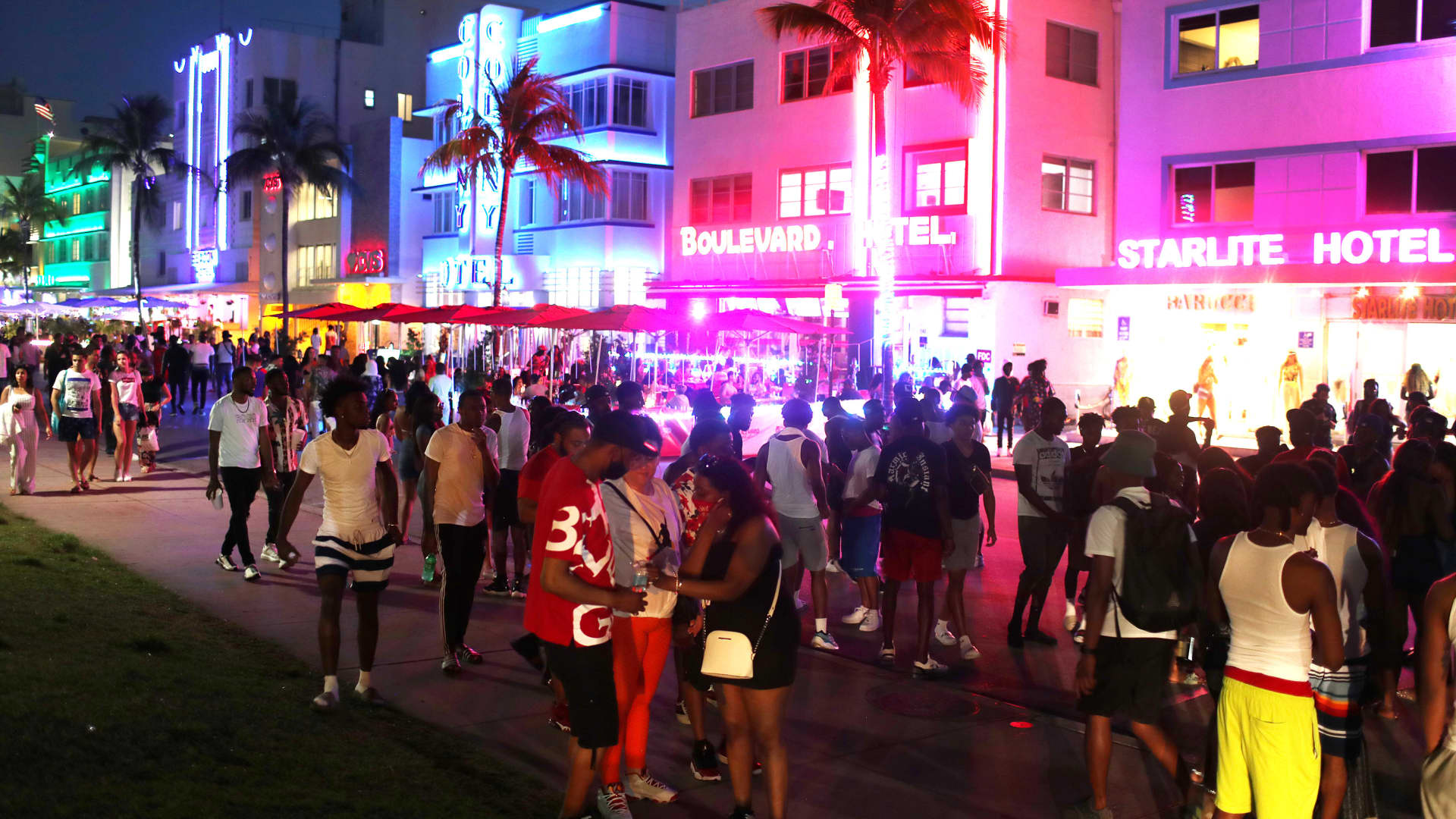 People enjoy themselves as they walk along Ocean Drive on March 18, 2021 in Miami Beach, Florida. College students have arrived in the South Florida area for the annual spring break ritual. City officials are concerned with large spring break crowds as the coronavirus pandemic continues.