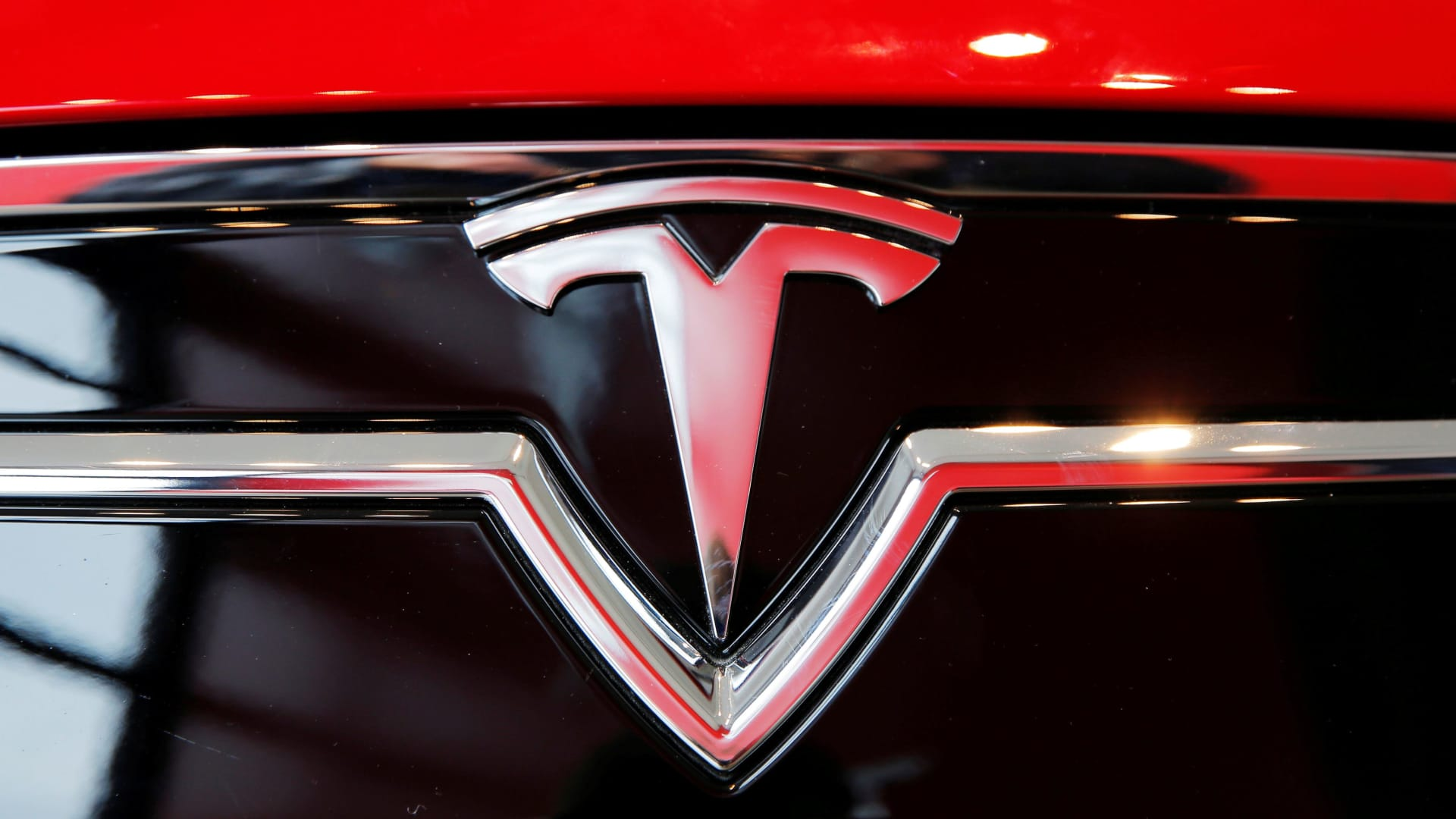 A Tesla logo on a Model S is photographed inside of a Tesla dealership in New York.