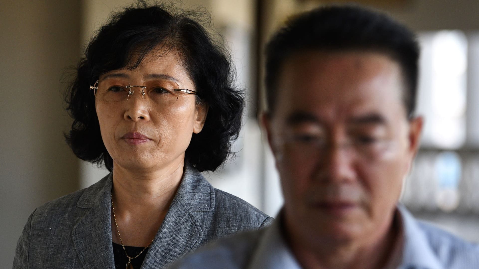 Kang Son Bi (L) wife of Mun Chol Myong, the North Korean man who faces possible extradition from Malaysia to the US on money-laundering charges arrives at the High Court in Kuala Lumpur on December 6, 2019.