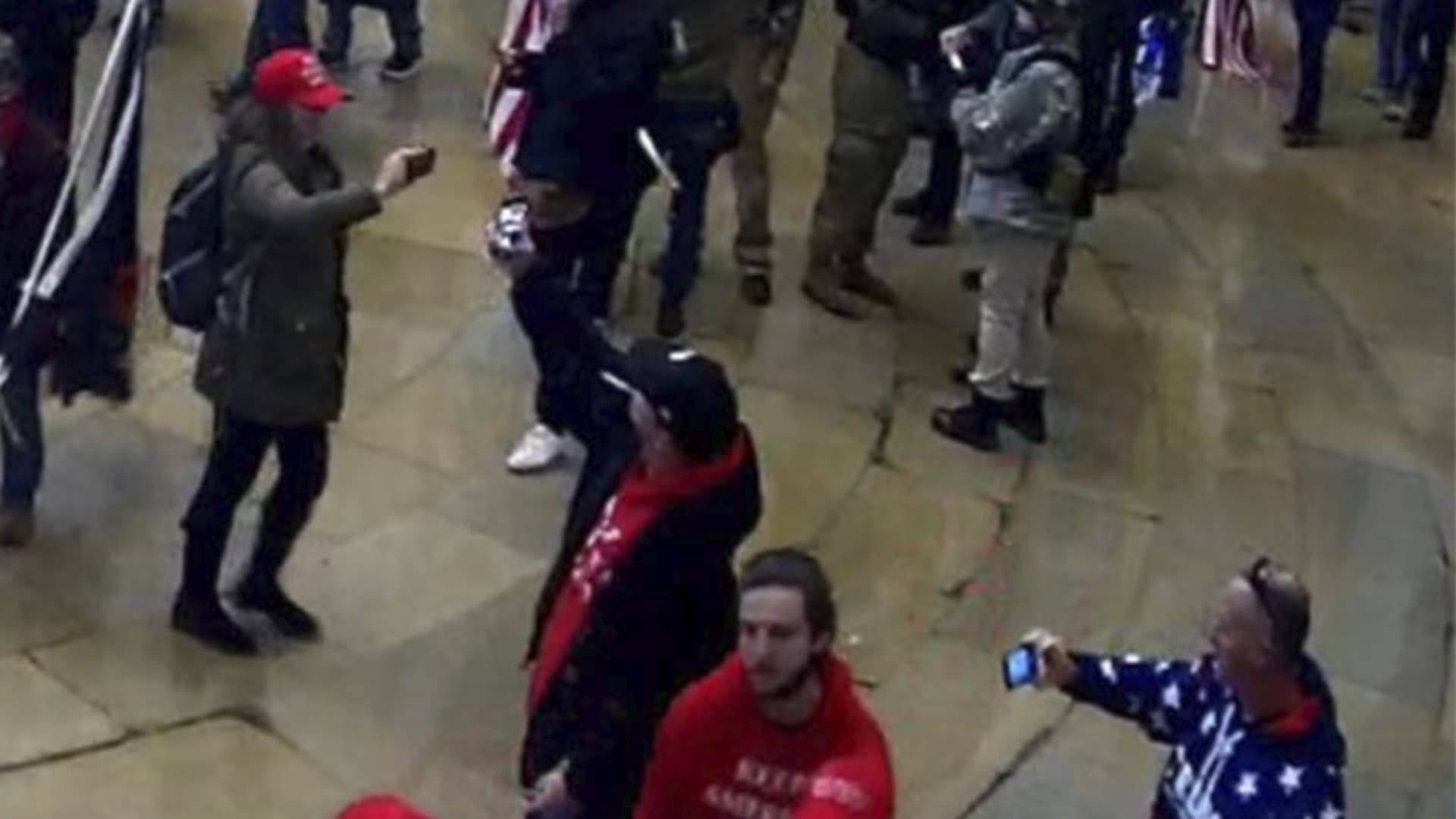 DOJ submits photos as part of a Statement of Facts, identifying Former NYPD officer Sara Carpenter (dressed in red hat, green jacket wearing a grey backpack), participating in the Capitol Riots on Jan. 6th, 2021.