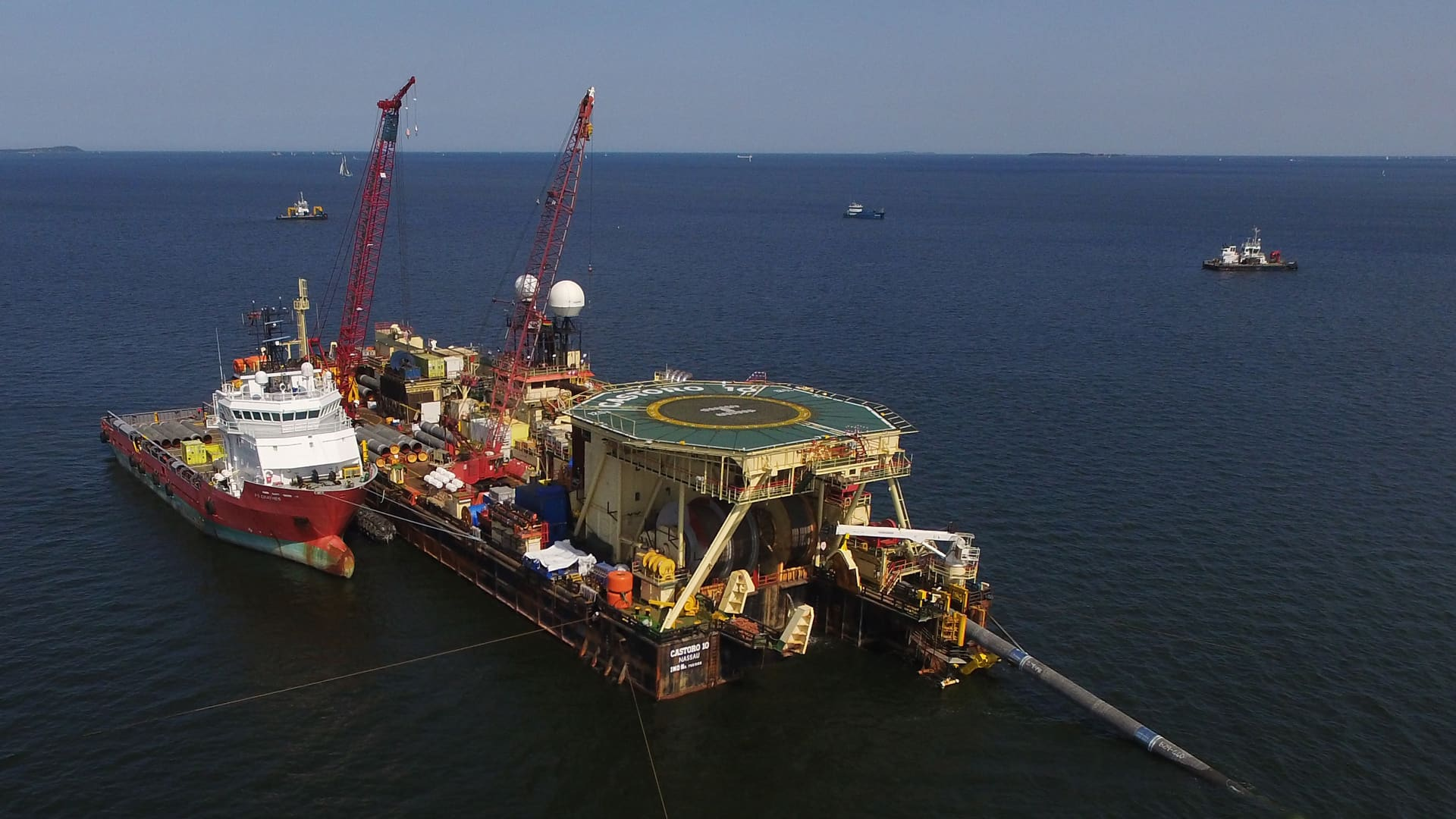 In this aerial view the Castoro 10 pipelay vessel lays concrete-coated pipe for the Nord Stream 2 gas pipeline onto the seabed of the Baltic Sea on August 16, 2018 near Lubmin, Germany.