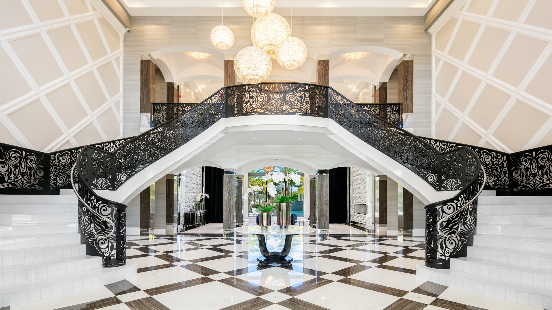 The foyer's grand double staircase