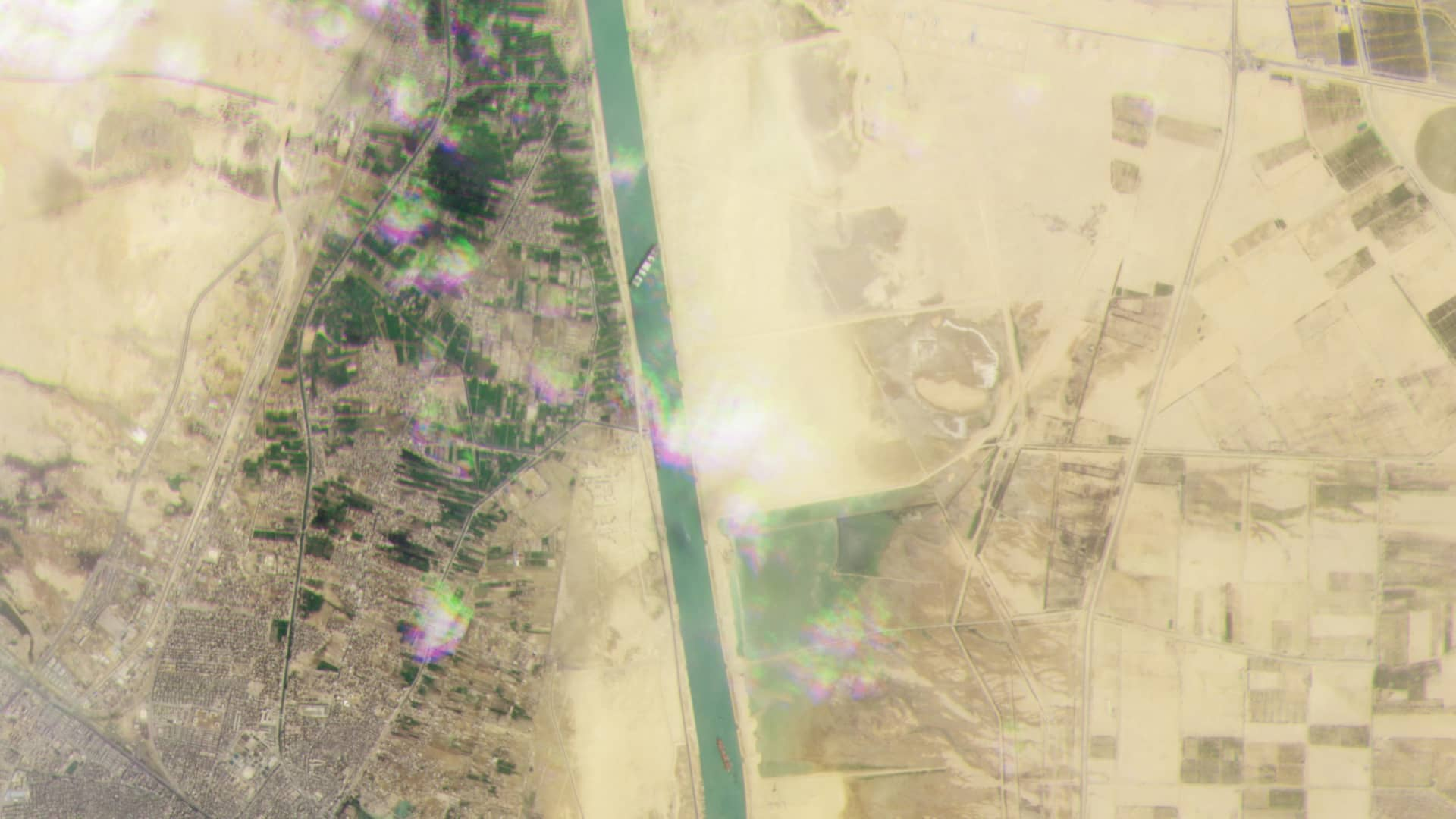 Satellite imagery captured on March 23, 2021 shows the cargo container ship Ever Given blocking the Suez Canal in Egypt.