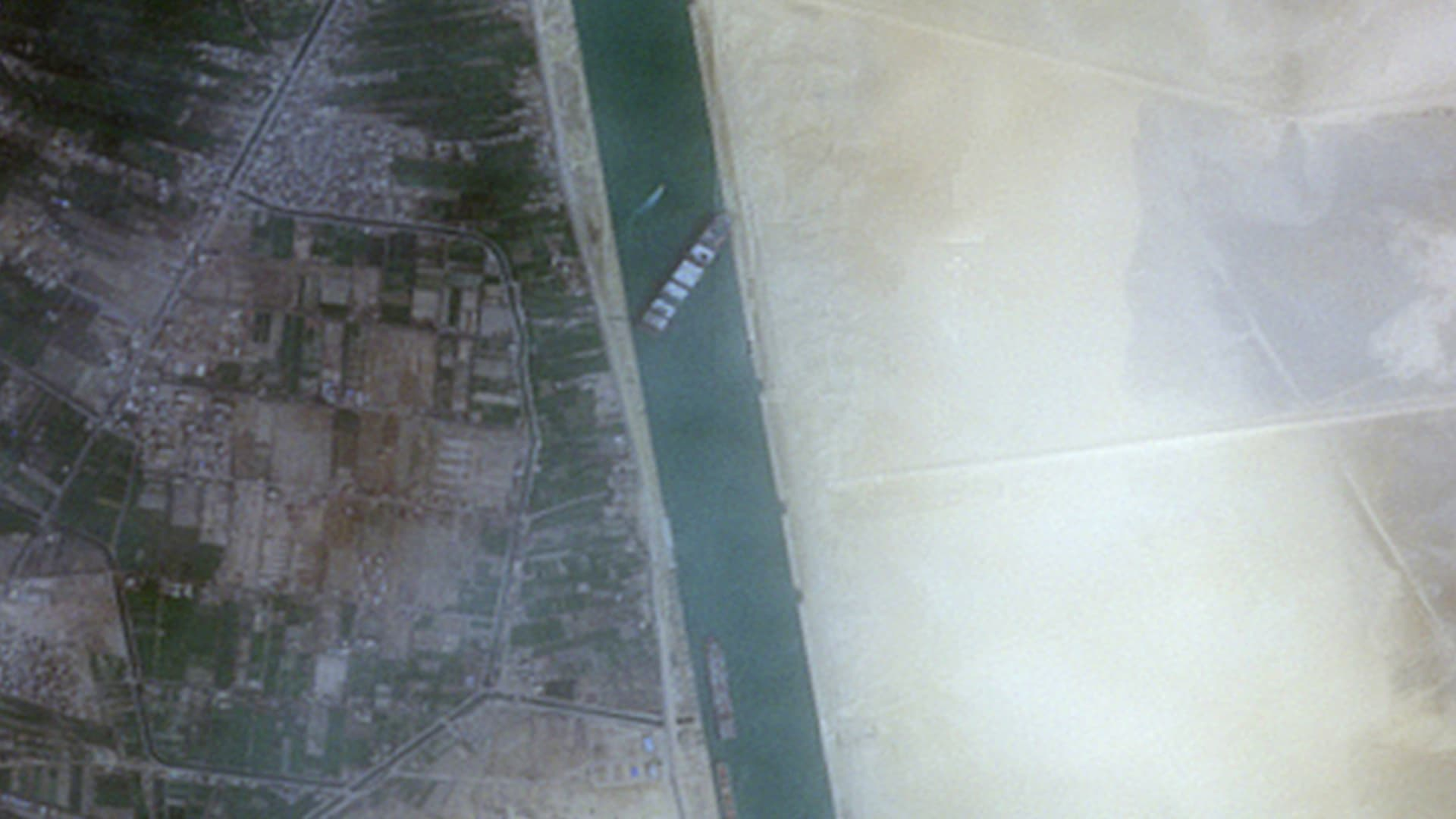Satellite images of container ship Ever Given stuck in Egypt's Suez Canal.