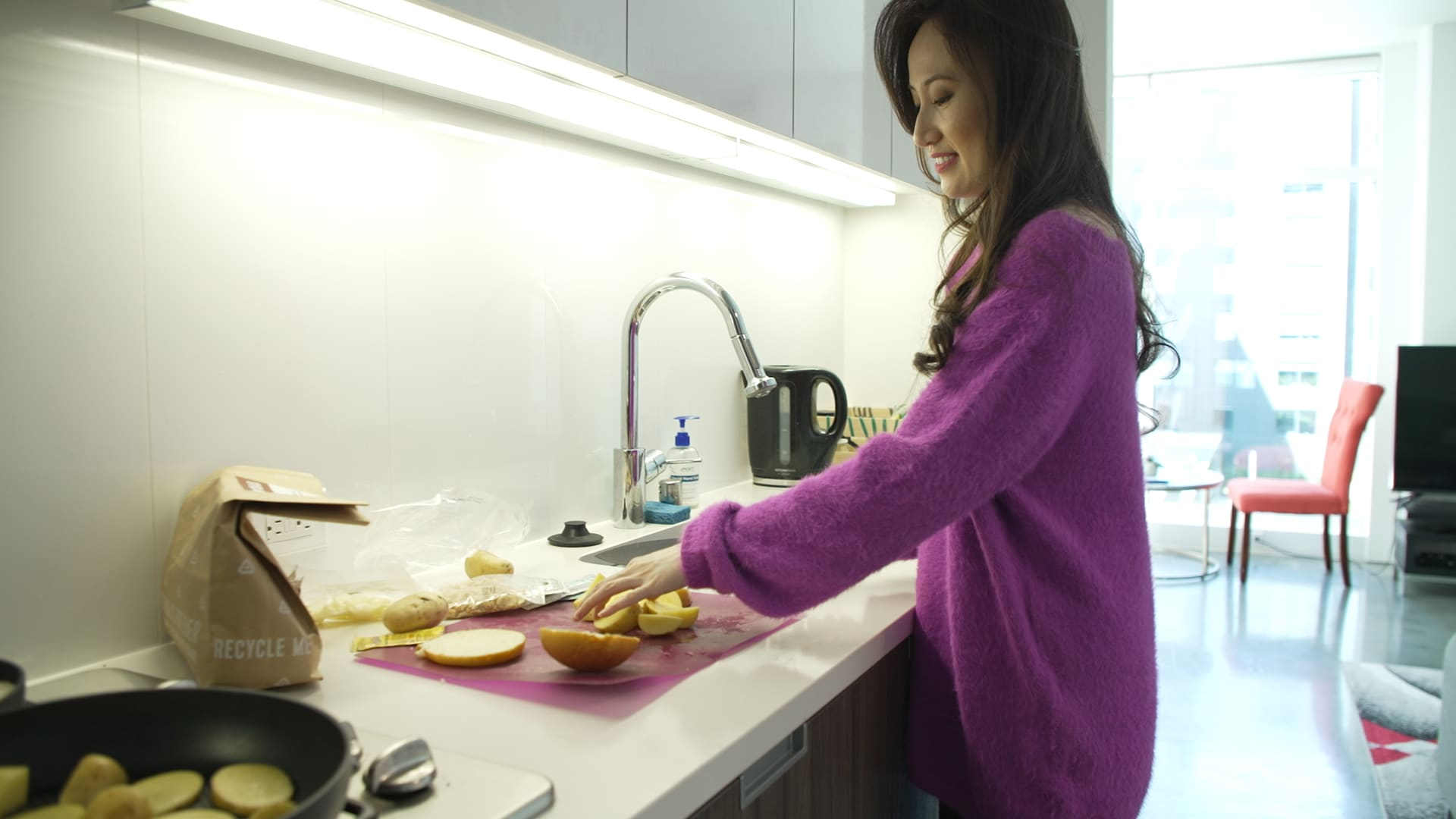 Shan Shan Fu cooks a meal in her apartment.