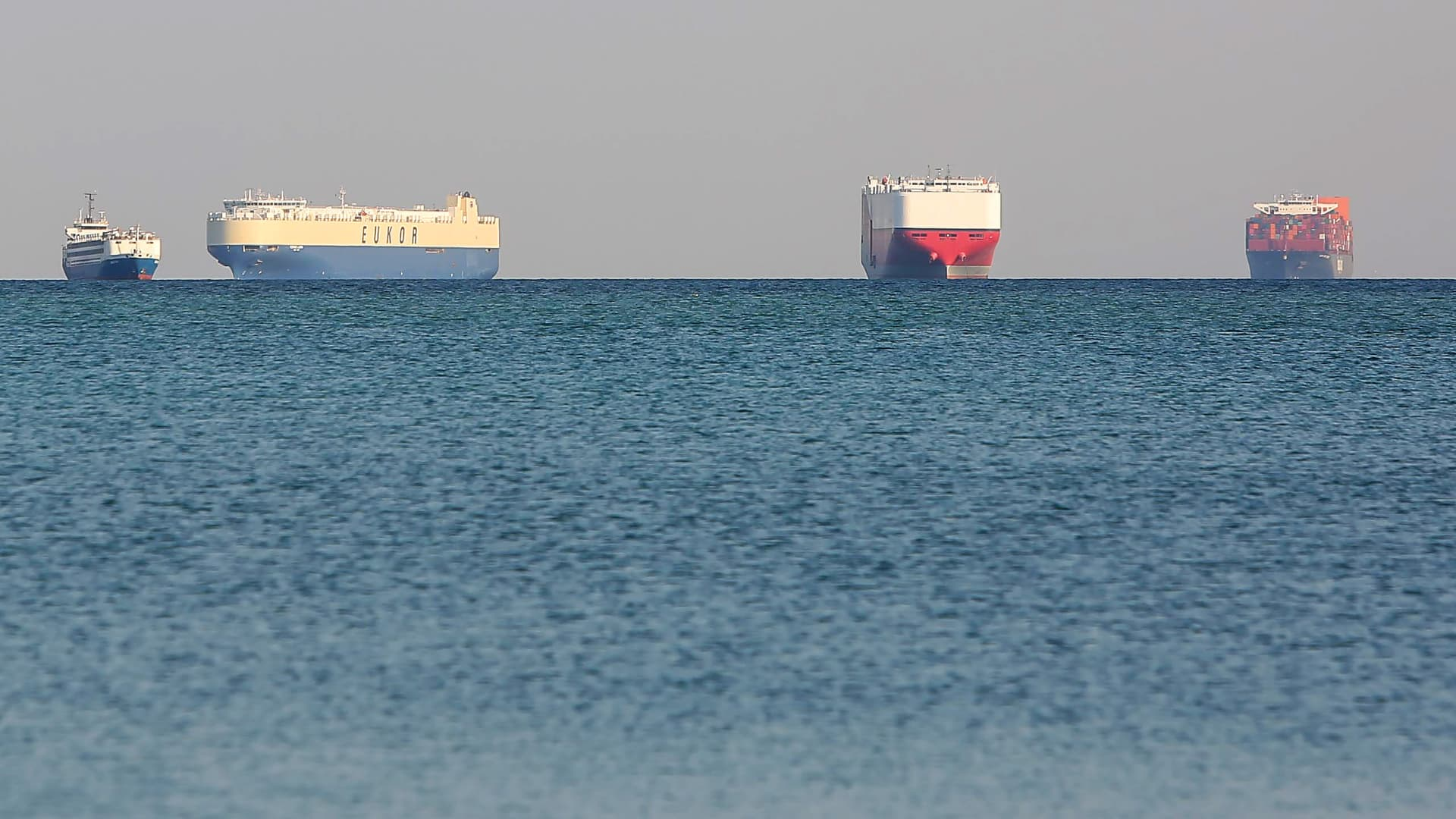 Commercial cargo and container ships ride anchor while waiting to transit the Suez Canal in Ismailia, Egypt, on Thursday, March 25, 2021.