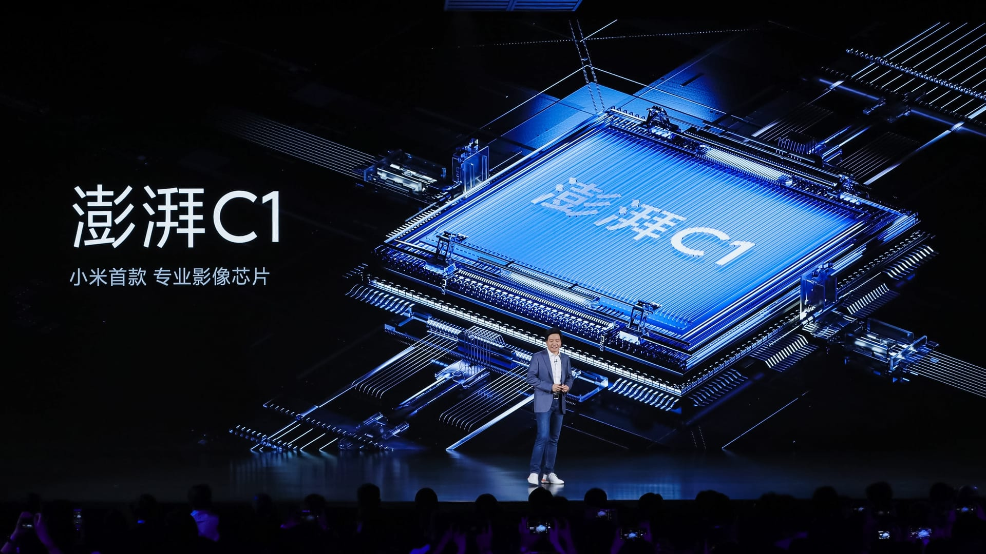 Xiaomi CEO Lei Jun unveils the company's first camera chipset called the Surge C1, during an event on Tuesday, March 30, 2021. It will feature in the company's Mi Mix Fold smartphone.