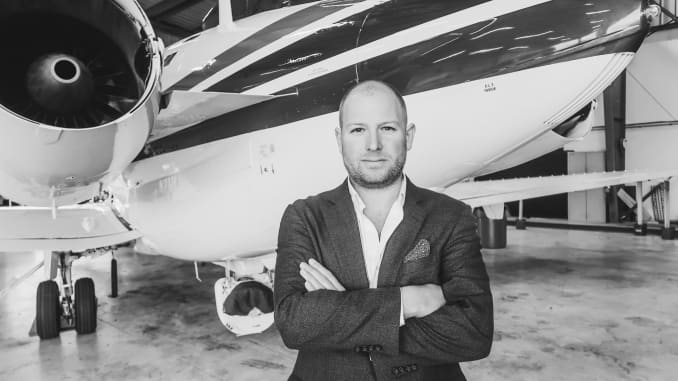 Covac Global CEO Ross Thompson stands in front of aircraft.