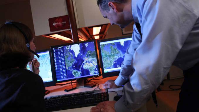 Medjet employees monitoring medical evacuations via computers.