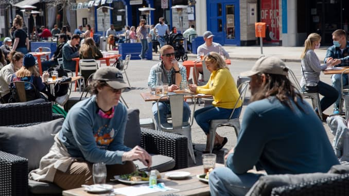 People crowd outdoor dining at a restaurant as coronavirus disease (COVID-19) restrictions are eased in Ann Arbor, Michigan, U.S., April 4, 2021.