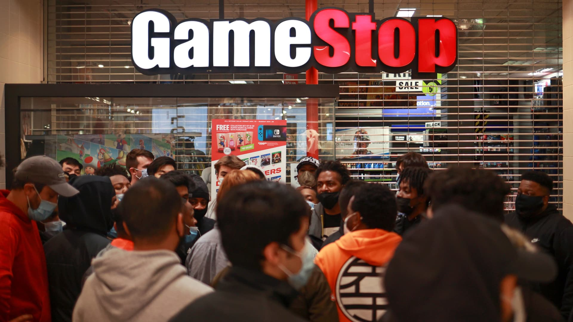 Shoppers wait for a GameStop store to open on at the Tysons Corner Center, in Tysons, Virginia, November 27, 2020.