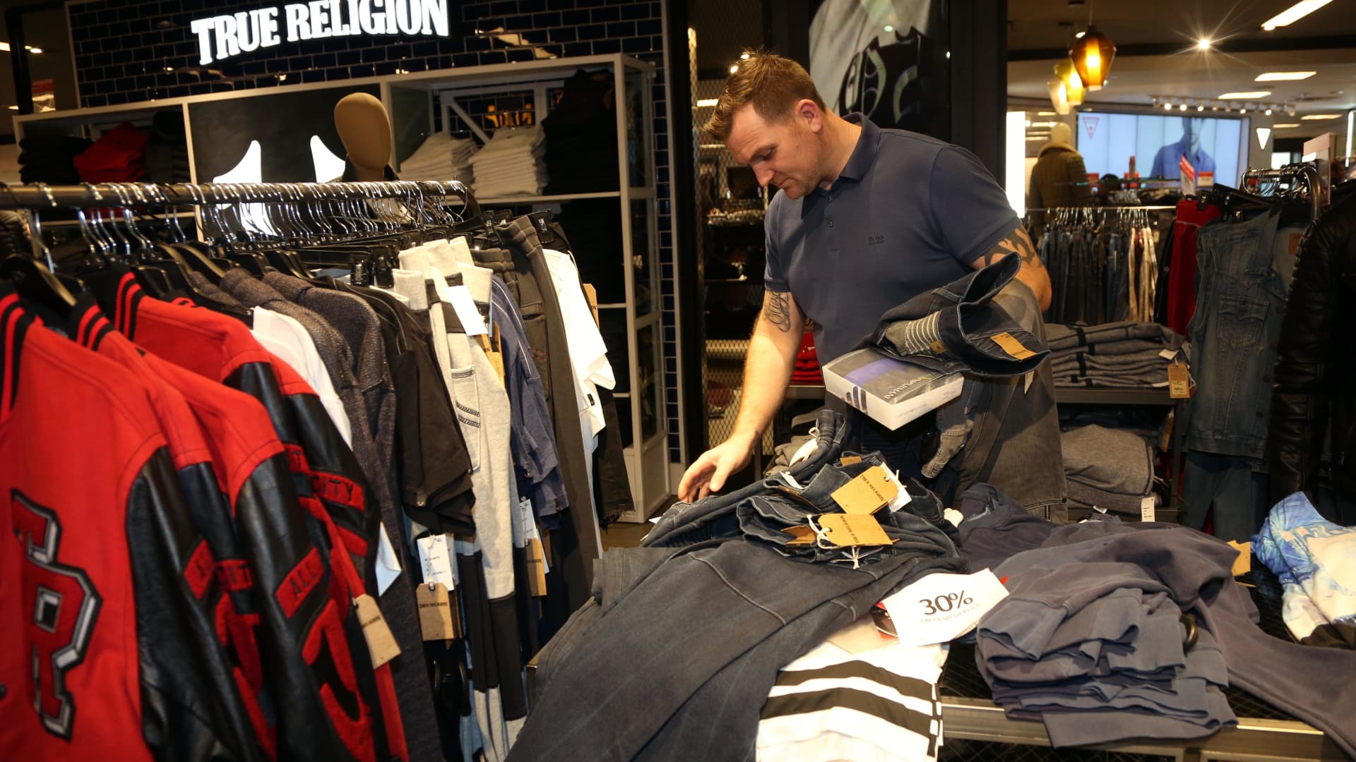 A man shops for clothes in Macy's department store in Herald Square, New York.