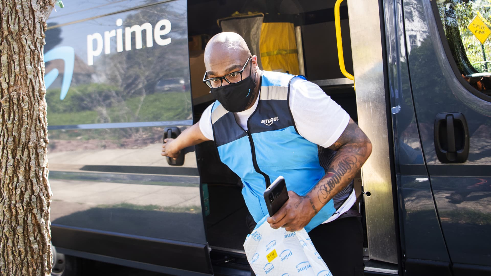 Amazon driver Shawndu Stackhouse delivers packages in Northeast Washington, D.C., on Tuesday, April 6, 2021.