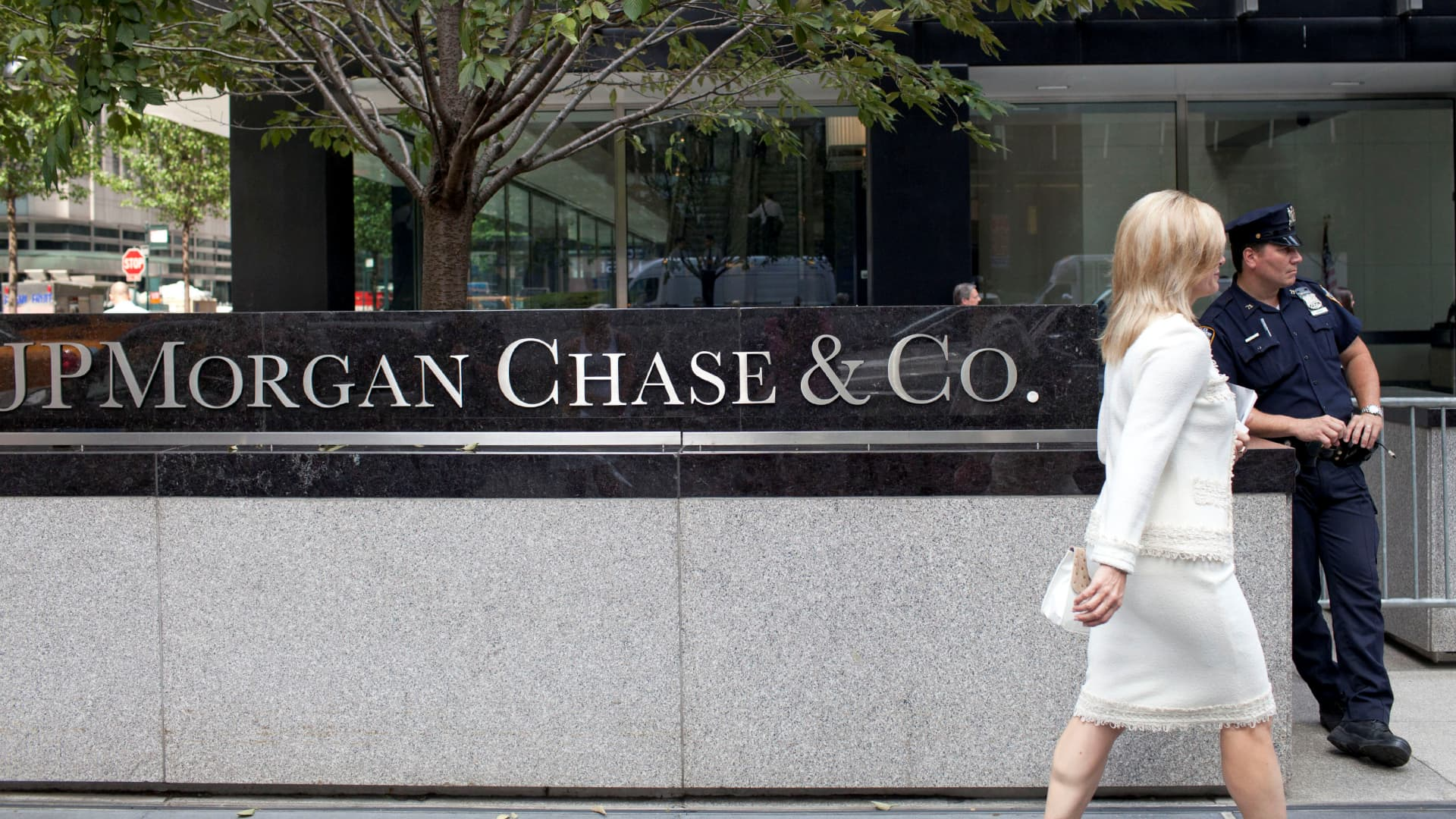 A woman walks past JPMorgan Chase & Co's international headquarters on Park Avenue in New York.