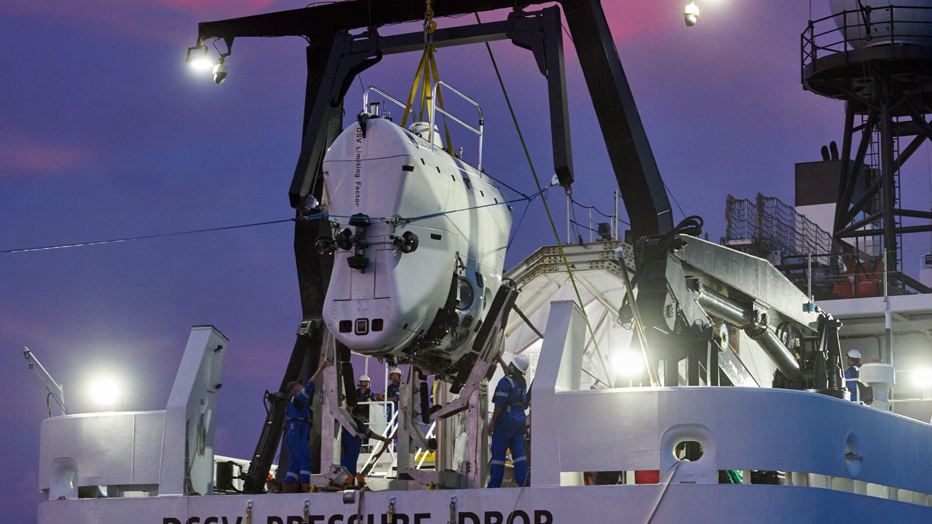 Deep ocean submarine DSV Limiting Factor is seen above the deck of the ship DSSV Pressure Drop.