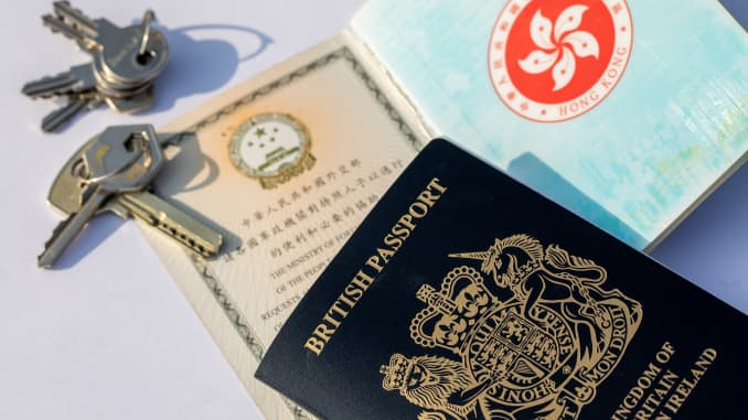 A British National (Overseas) passport, top, with Hong Kong Special Administrative Region (HKSAR) passport.