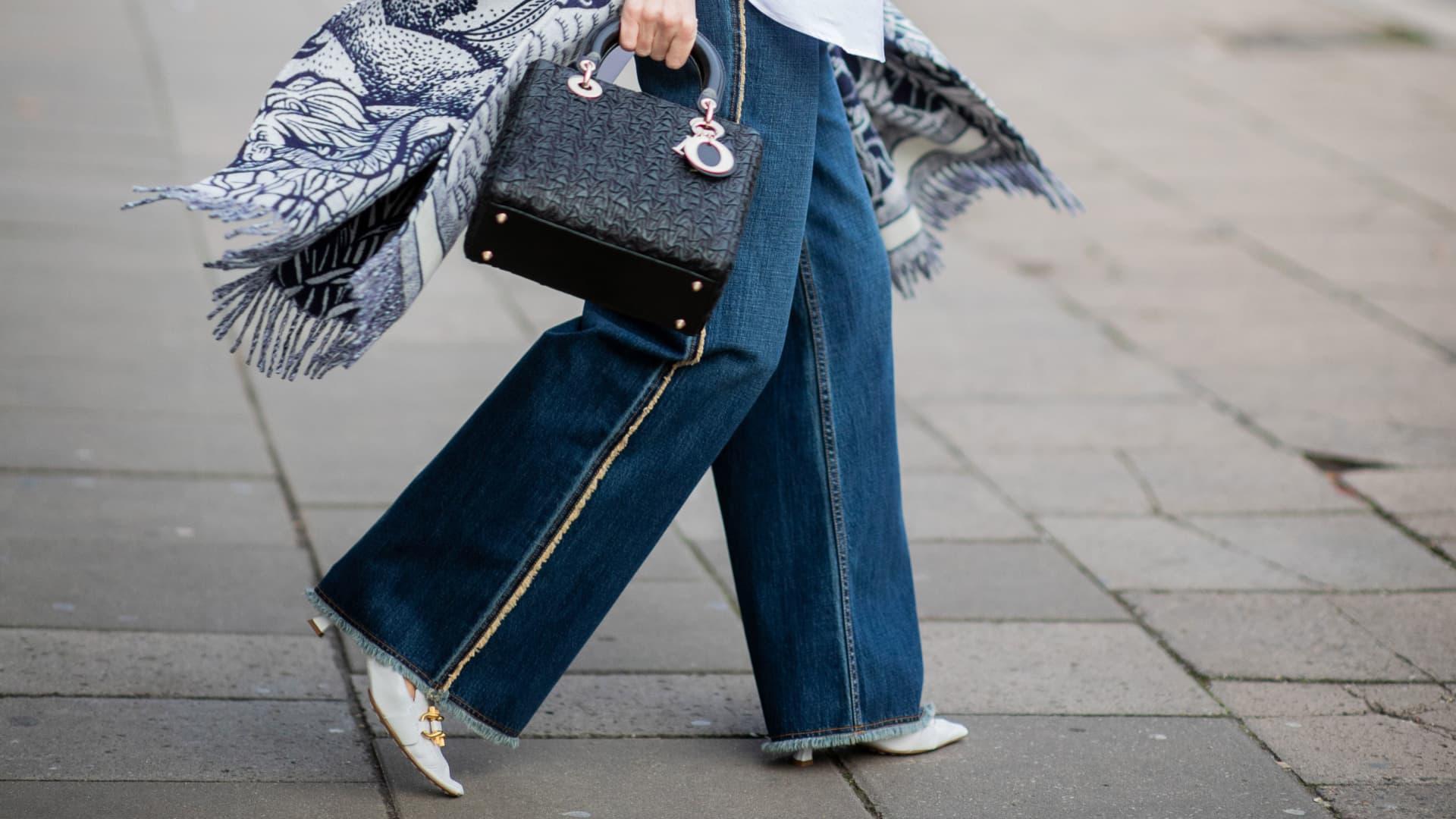 Alexandra Lapp is seen wearing white shoes Bottega Veneta, wide leg denim jeans during the Berlin Fashion Week Autumn/Winter 2020 on January 15, 2020 in Berlin, Germany.