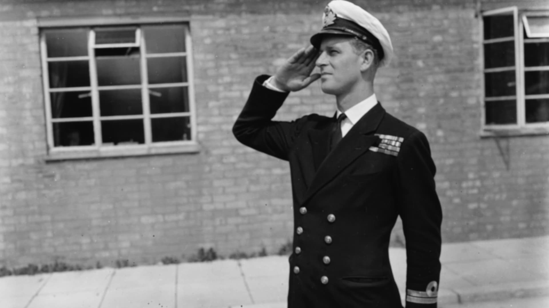 Lt. Philip Mountbatten, prior to his marriage to Princess Elizabeth, saluting as he resumes his attendance at the Royal Naval Officers School at Kingsmoor, Hawthorn, England, July 31, 1947.