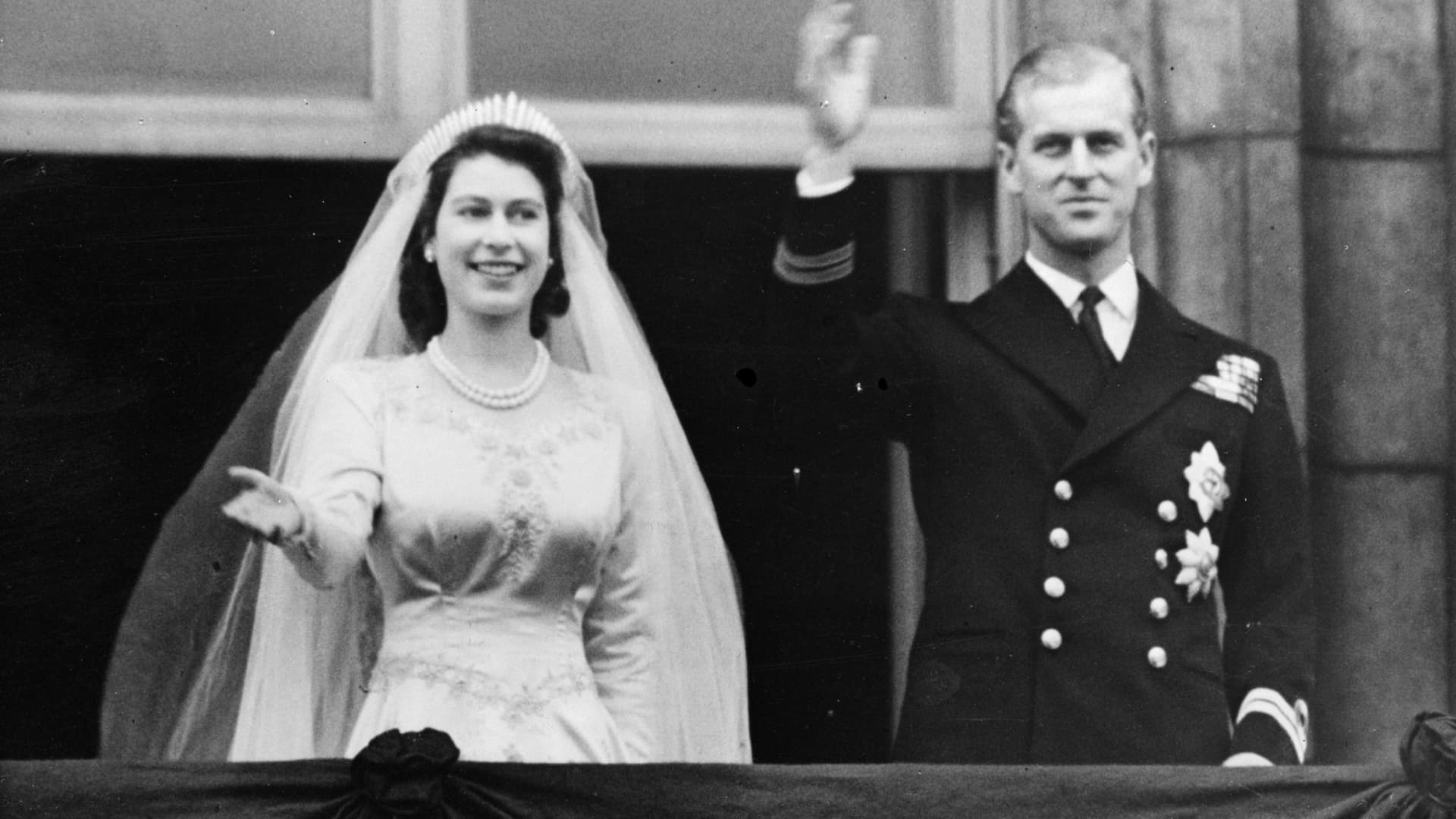 Princess Elizabeth and Prince Philip, Duke of Edinburgh, waving to a crowd from the balcony of Buckingham Palace, London shortly after their wedding at Westminster Abbey.