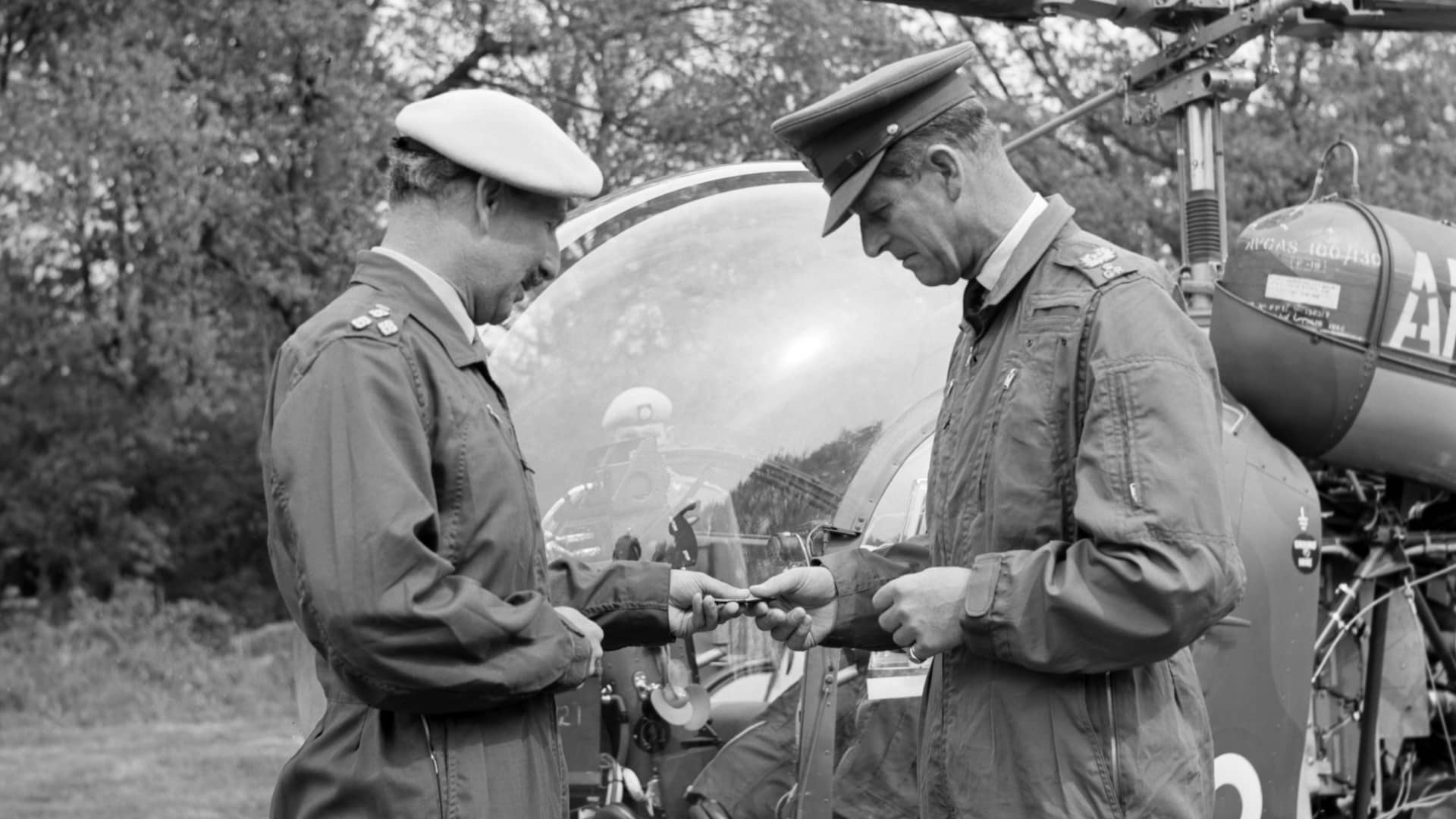 Prince Philip, in flying overalls, being presented with his army wings by Brigadier Colin Kennedy, commandant of the Army Air Corps Centre, during the duke's visit.