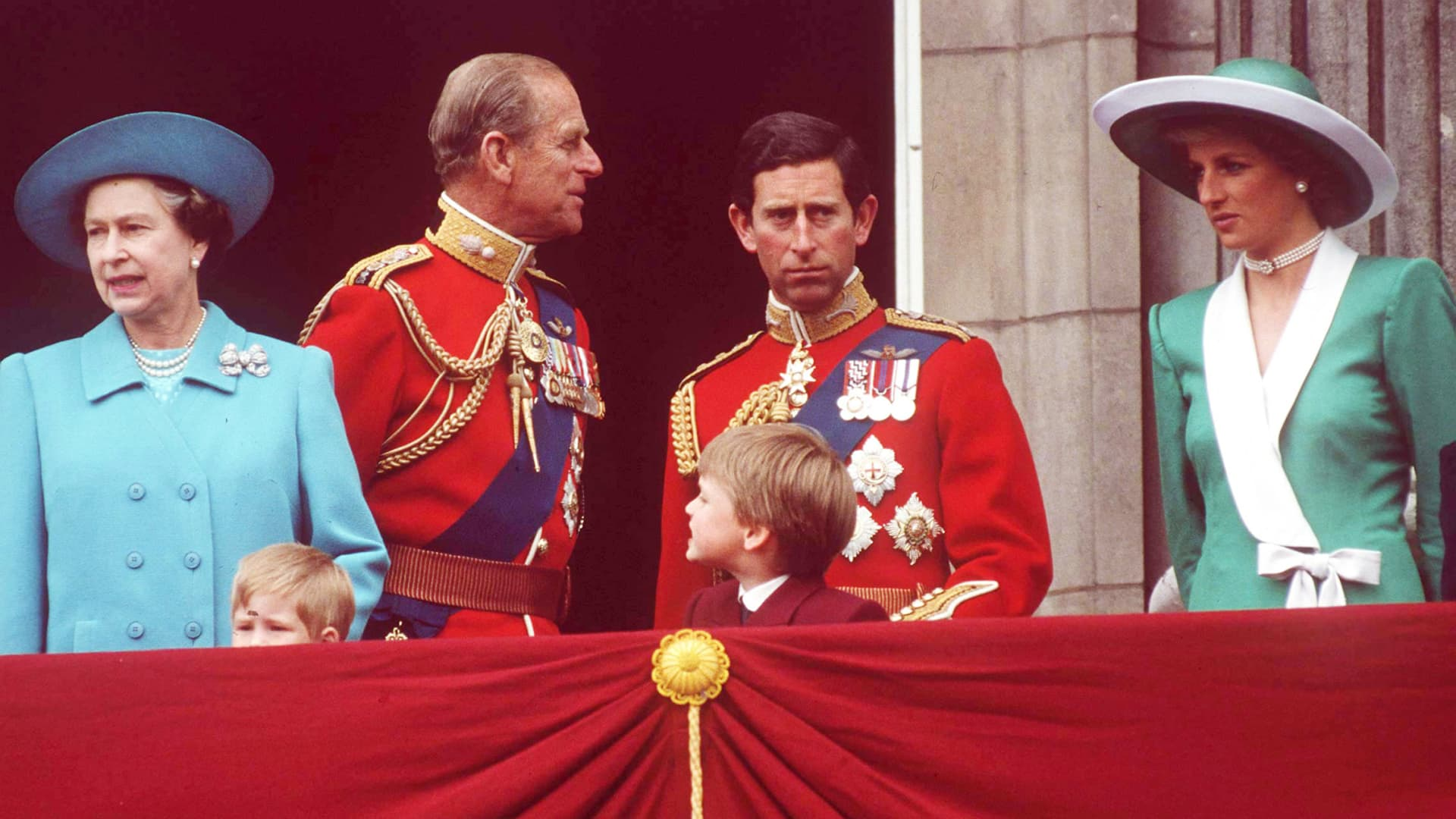 Queen Elizabeth, Prince Philip, Prince Charles and Princess Diana at Buckingham Palace for Trooping the Colour. In front are Prince Harry and Prince William.